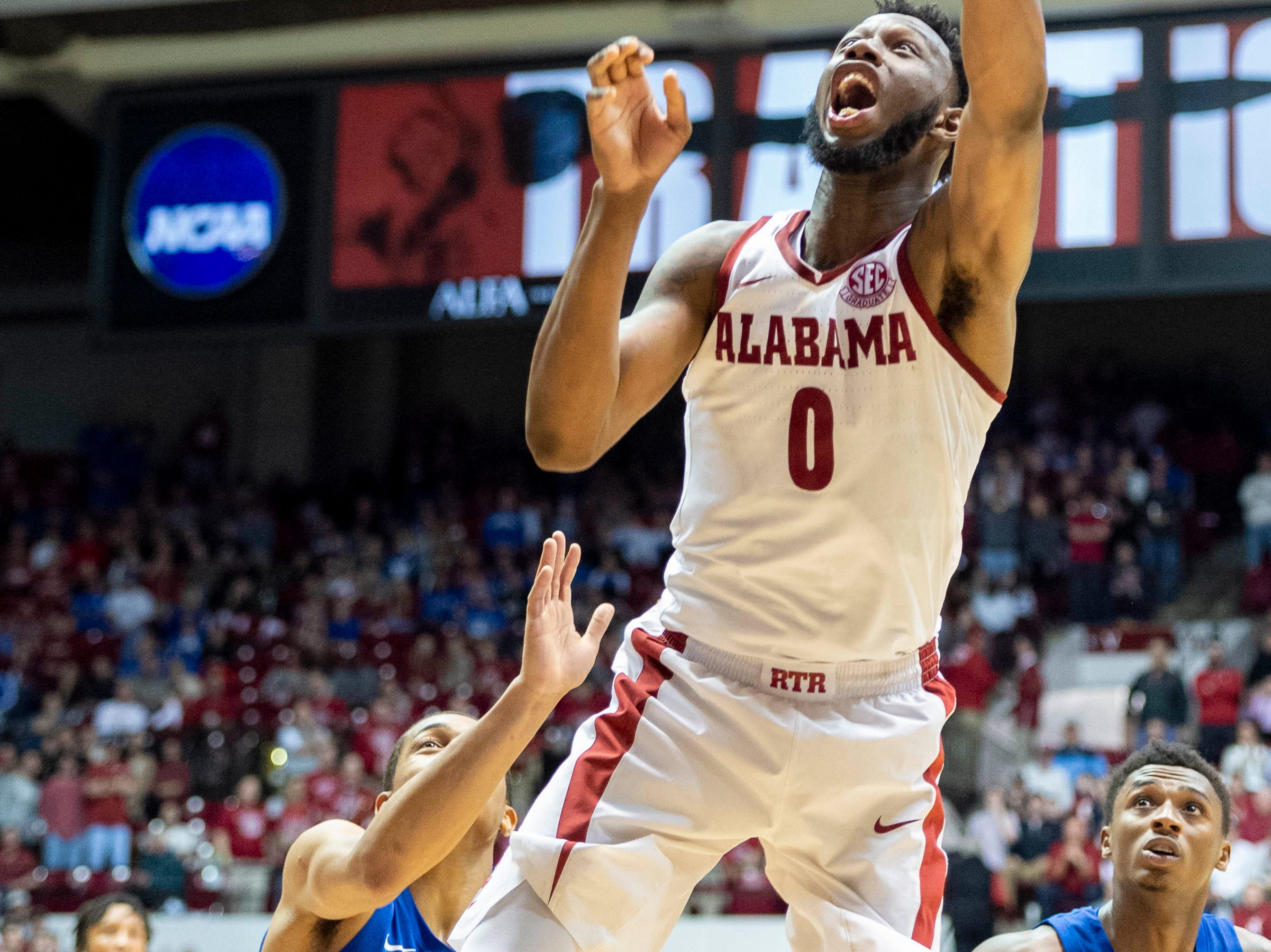 Alabama forward Donta Hall (0) tips in a rebound for two against Kentucky during the second half of an NCAA college basketball game, Saturday, Jan. 5, 2019, in Tuscaloosa, Ala.