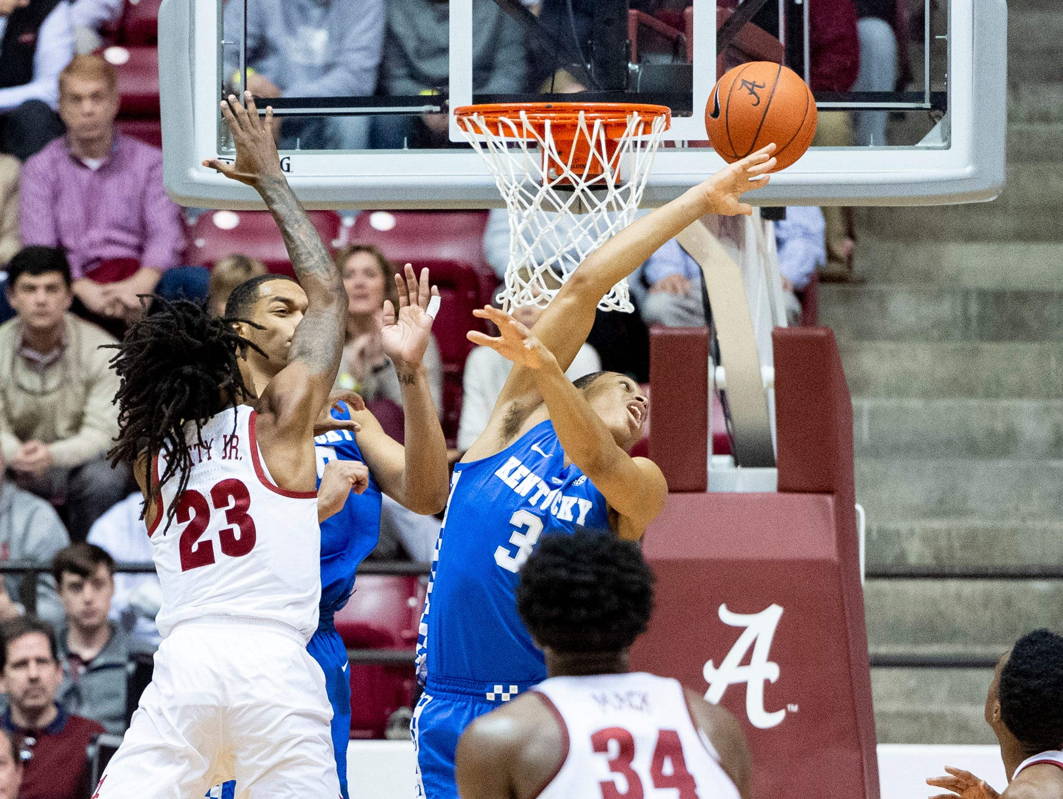 Kentucky guard Keldon Johnson (3) swats away a rebound from Alabama guard John Petty (23) during the first half of an NCAA college basketball game, Saturday, Jan. 5, 2019, in Tuscaloosa, Ala.