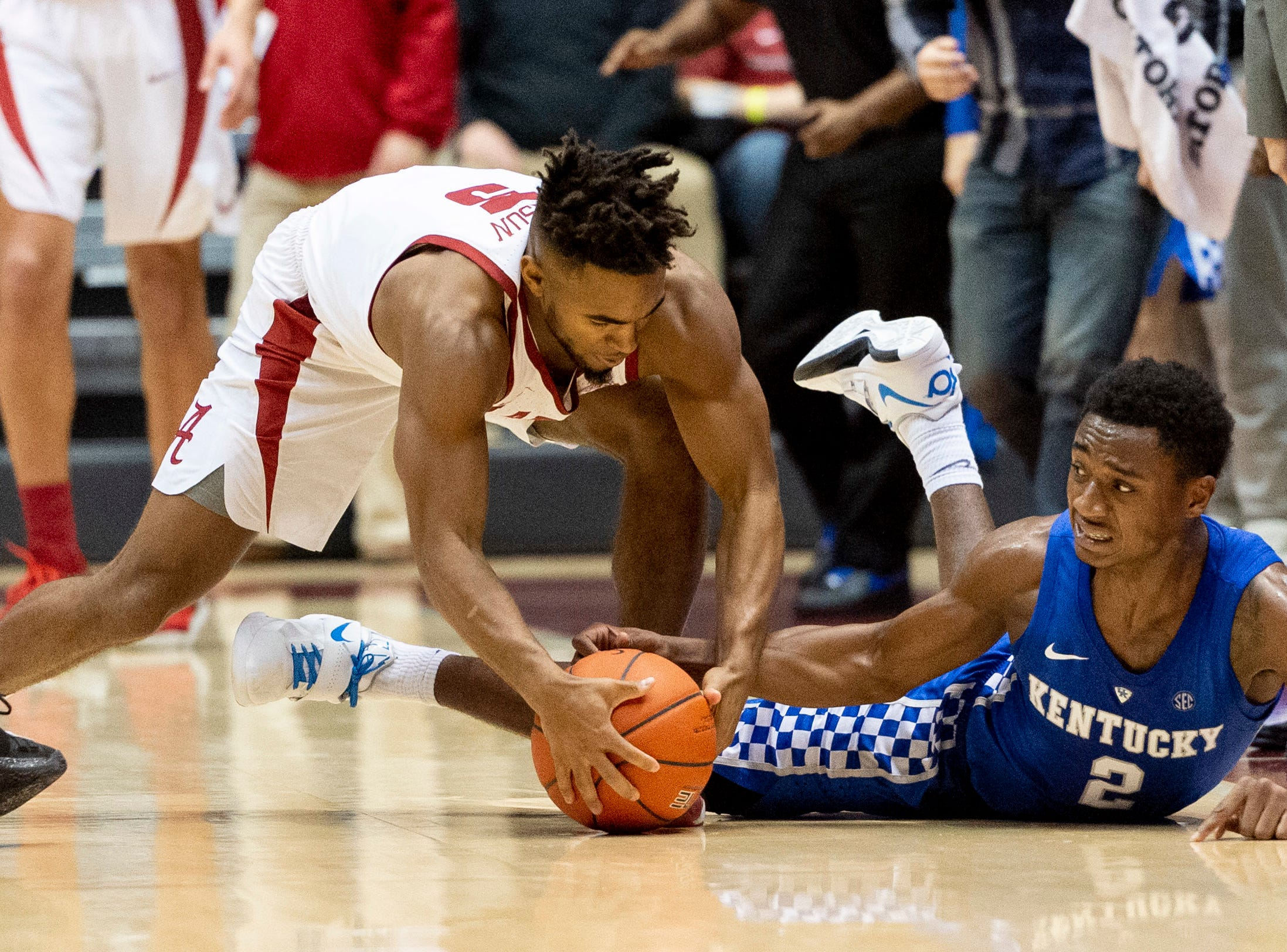 Kentucky guard Ashton Hagans (2) tries for a steal from Alabama guard Avery Johnson Jr. (5) during the first half of an NCAA college basketball game, Saturday, Jan. 5, 2019.