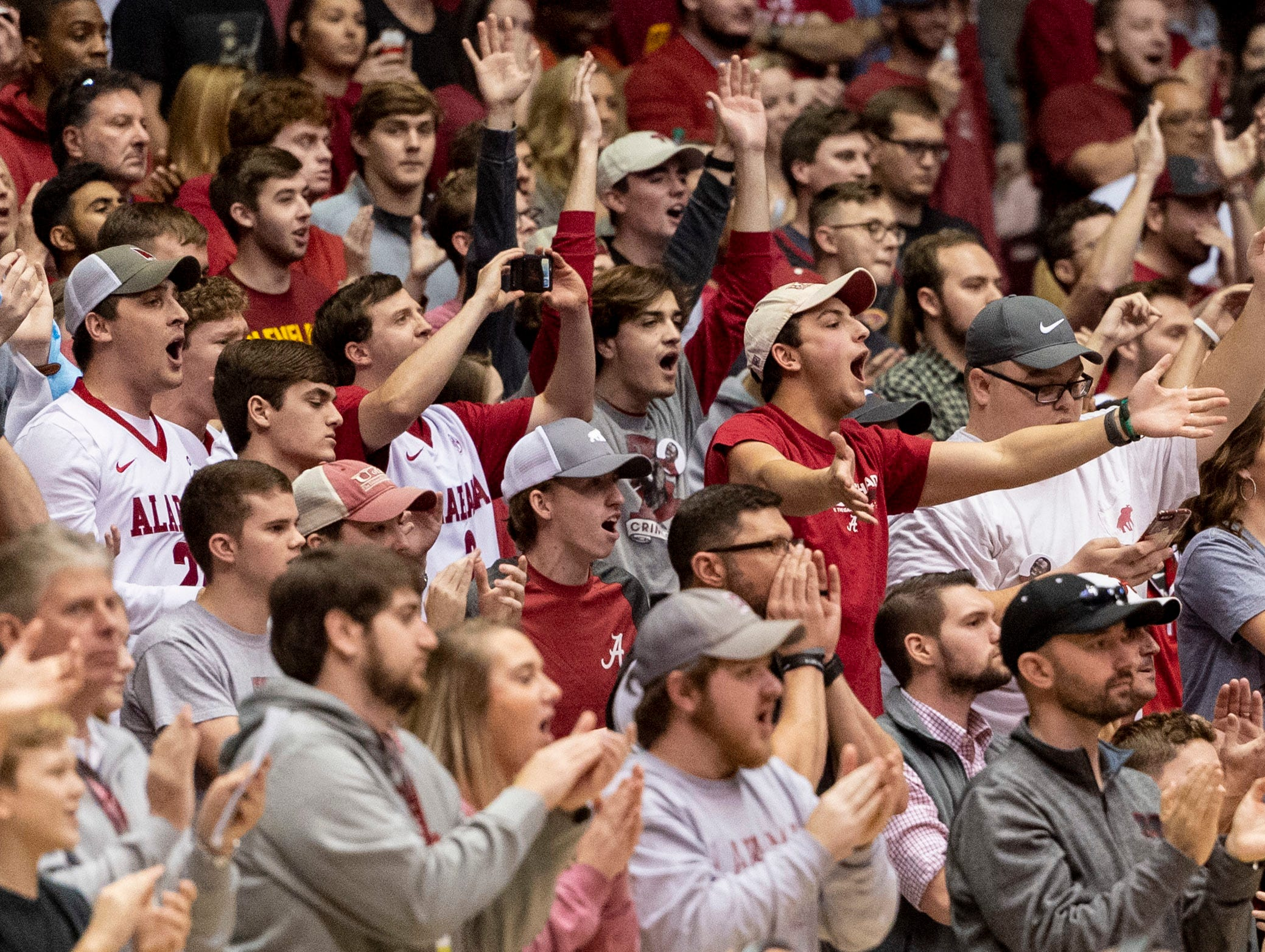 Alabama fans cheer in an upset win over Kentucky during the second half of an NCAA college basketball game, Saturday, Jan. 5, 2019, in Tuscaloosa, Ala.