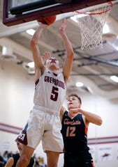 Eaton Rapids' RJ VanVliet, left, shoots against Charlotte's Cameron Wertz, Friday, Jan. 4, 2019, in Eaton Rapids, Mich.