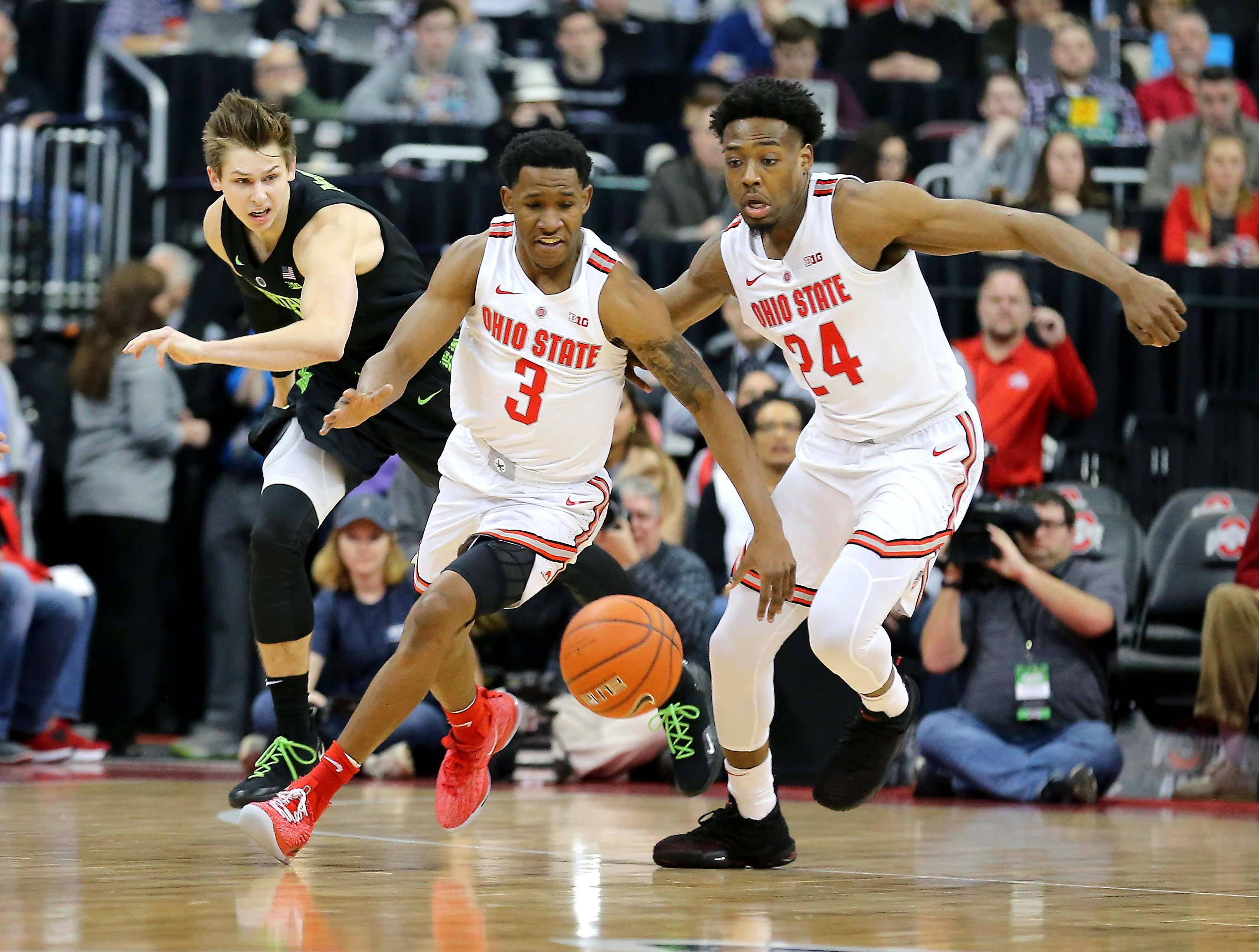 Jan 5, 2019; Columbus, OH, USA; Ohio State Buckeyes guard C.J. Jackson (3) steals from Michigan State Spartans guard Matt McQuaid (20) as Buckeyes forward Andre Wesson (24) looks on during the first half at Value City Arena. Mandatory Credit: Joe Maiorana-USA TODAY Sports