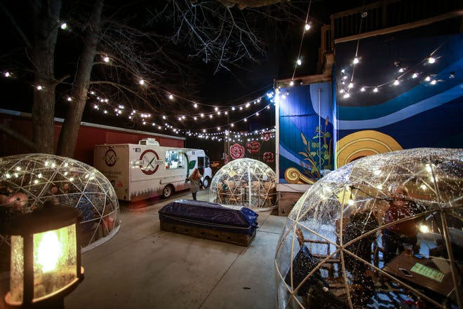 The outdoor patio area at BAD Brewing Company in Mason, Friday, Jan. 4, 2019. BAD has three heated and lit 'igloos,' or geodesic pop-up domes for wintertime patio seating. Each dome has seating for up to 11 people.