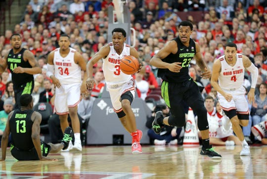 Jan 5, 2019; Columbus, OH, USA; Ohio State Buckeyes guard C.J. Jackson (3) steals from Michigan State Spartans forward Xavier Tillman (23) during the first half at Value City Arena. Mandatory Credit: Joe Maiorana-USA TODAY Sports