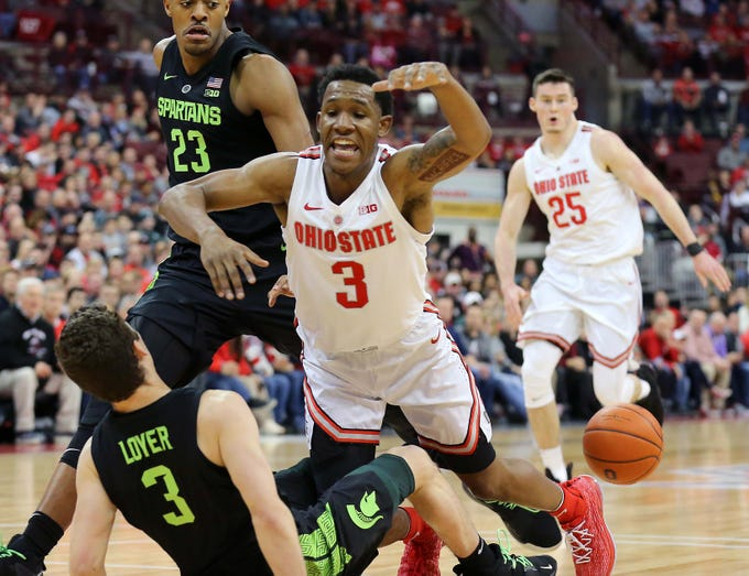 Jan 5, 2019; Columbus, OH, USA; Ohio State Buckeyes guard C.J. Jackson (3) is fouled by Michigan State Spartans guard Foster Loyer (3) during the first half at Value City Arena. Mandatory Credit: Joe Maiorana-USA TODAY Sports