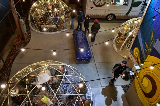 Guests in the outdoor patio area at BAD Brewing Company in Mason, Friday, Jan. 4, 2019. BAD has three heated and lit 'igloos,' or geodesic pop-up domes for wintertime patio seating. Each dome has seating for up to 11 people.