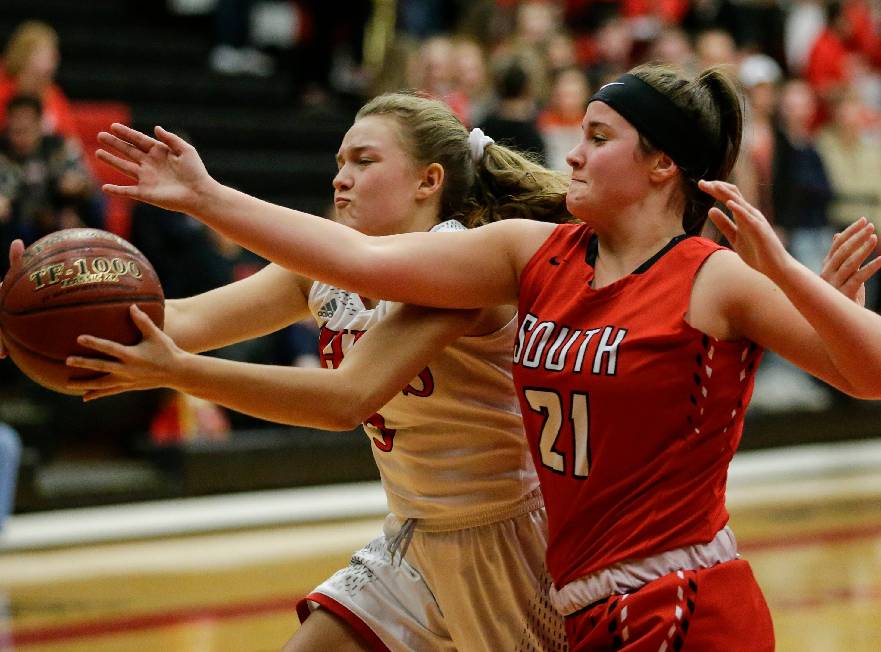 Manitowoc Lincoln's Lauren Delmore (3) battles Sheboygan South's Dina Bushi for a loose ball during an FRCC matchup at Manitowoc Lincoln High School Friday, January 4, 2019, in Manitowoc, Wis. Joshua Clark/USA TODAY NETWORK-Wisconsin