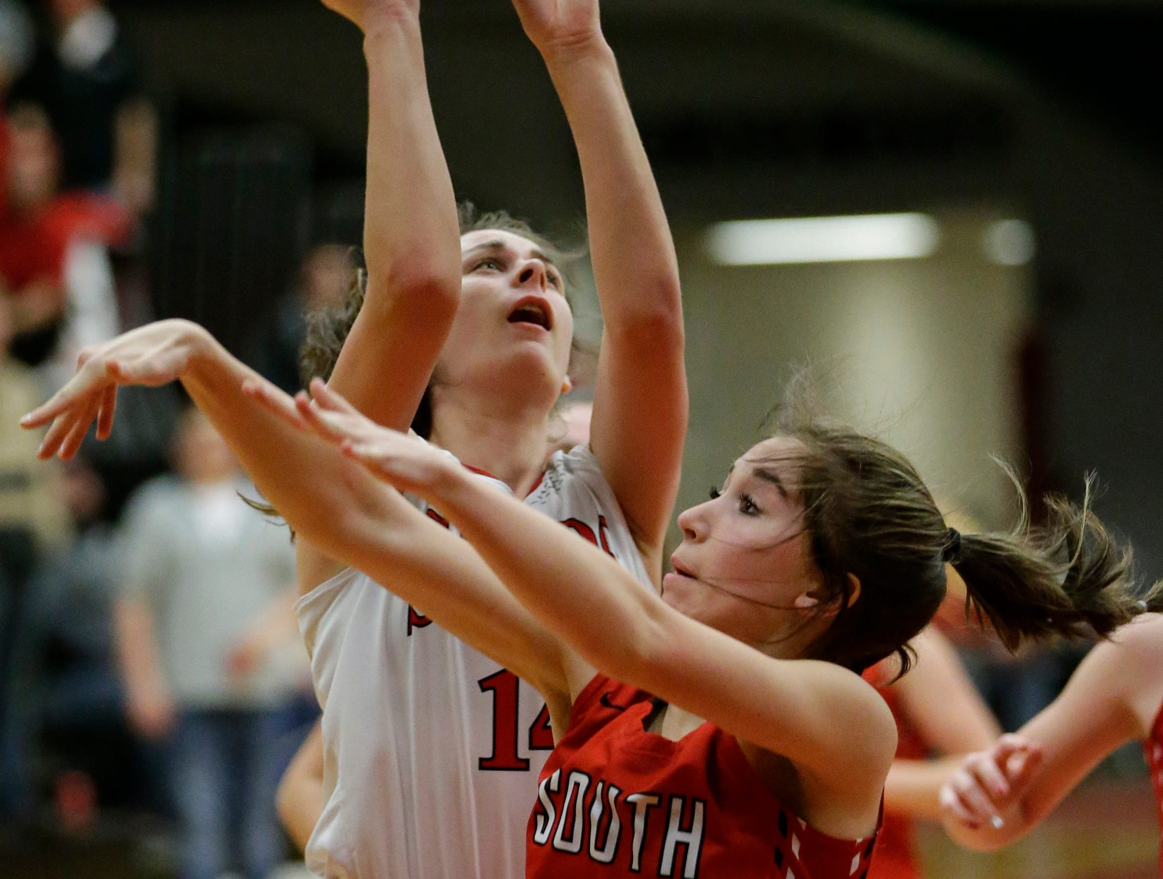 Manitowoc Lincoln's Claire Swoboda (14) drives for a layup over Sheboygan South's Kaitlyn Stricker during an FRCC matchup at Manitowoc Lincoln High School Friday, January 4, 2019, in Manitowoc, Wis. Joshua Clark/USA TODAY NETWORK-Wisconsin