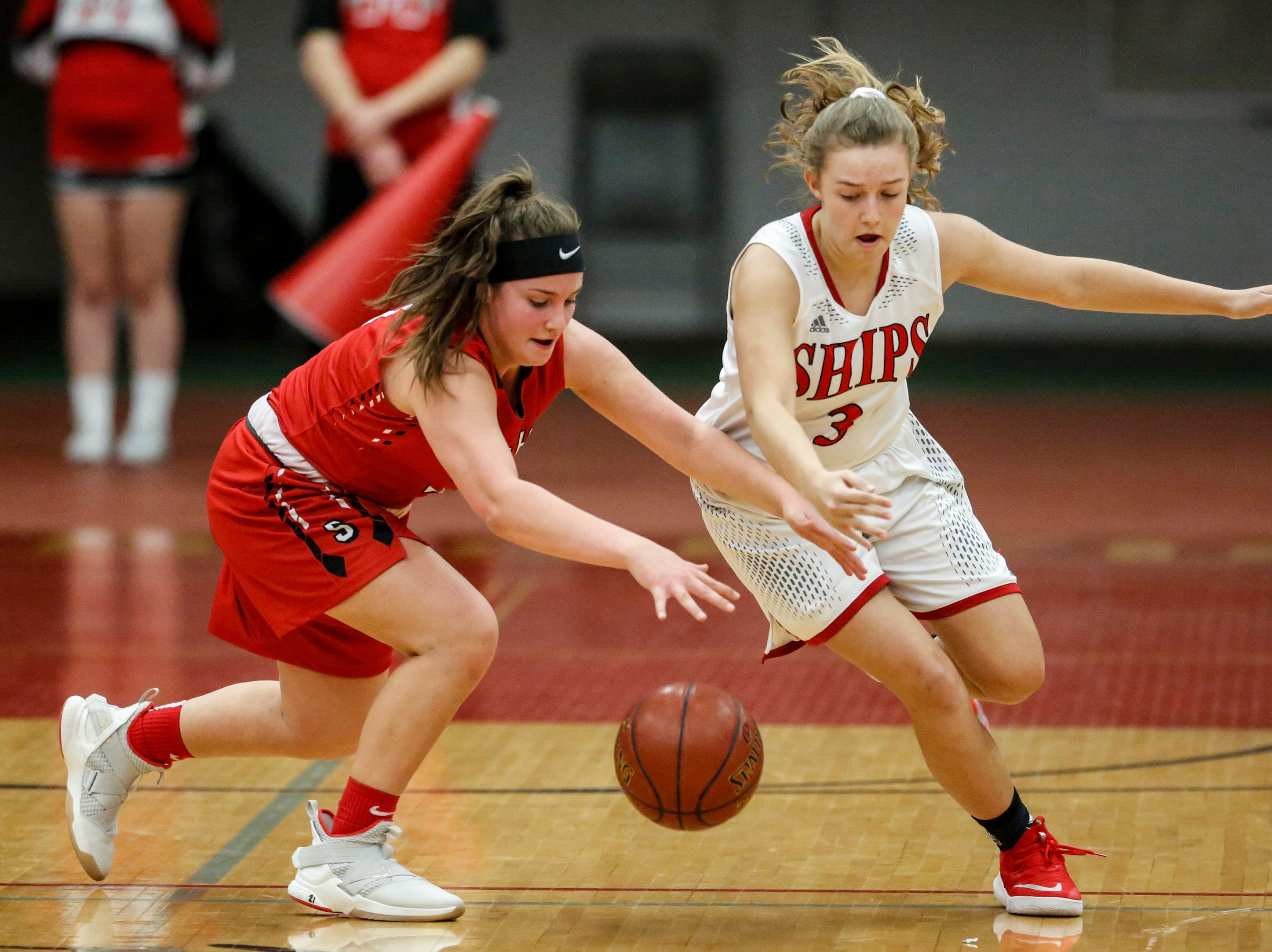 Manitowoc Lincoln's Lauren Delmore swipes the ball away from Sheboygan South's Dina Bushi (21) during an FRCC matchup at Manitowoc Lincoln High School Friday, January 4, 2019, in Manitowoc, Wis. Joshua Clark/USA TODAY NETWORK-Wisconsin