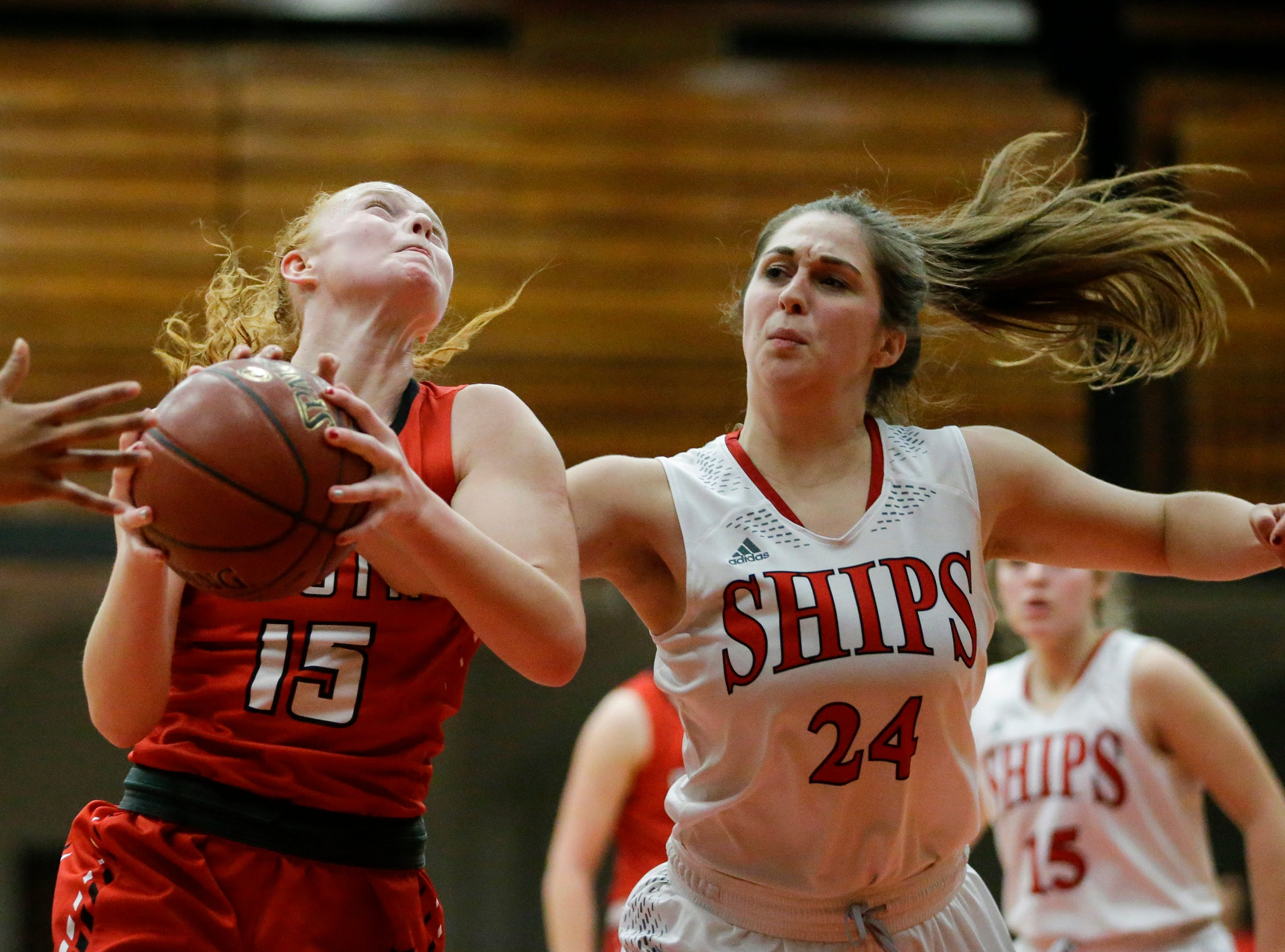 Sheboygan South's Lindsey Horen grabs a rebound over Manitowoc Lincoln's Morgan Bartow during an FRCC matchup at Manitowoc Lincoln High School Friday, January 4, 2019, in Manitowoc, Wis. Joshua Clark/USA TODAY NETWORK-Wisconsin