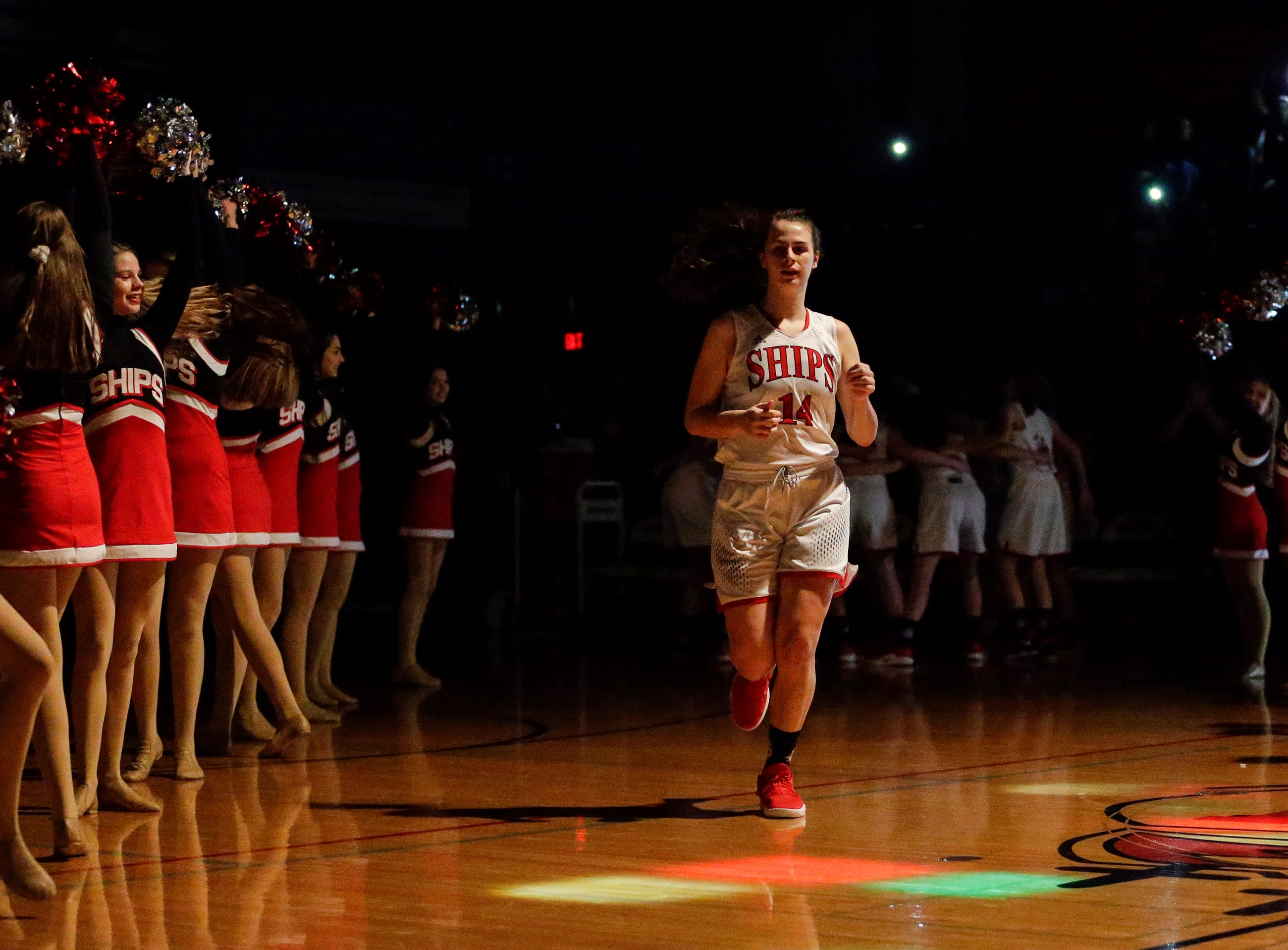 Manitowoc Lincoln's Claire Swoboda runs onto the court during introductions before an FRCC matchup against Sheboygan South at Manitowoc Lincoln High School Friday, January 4, 2019, in Manitowoc, Wis. Joshua Clark/USA TODAY NETWORK-Wisconsin