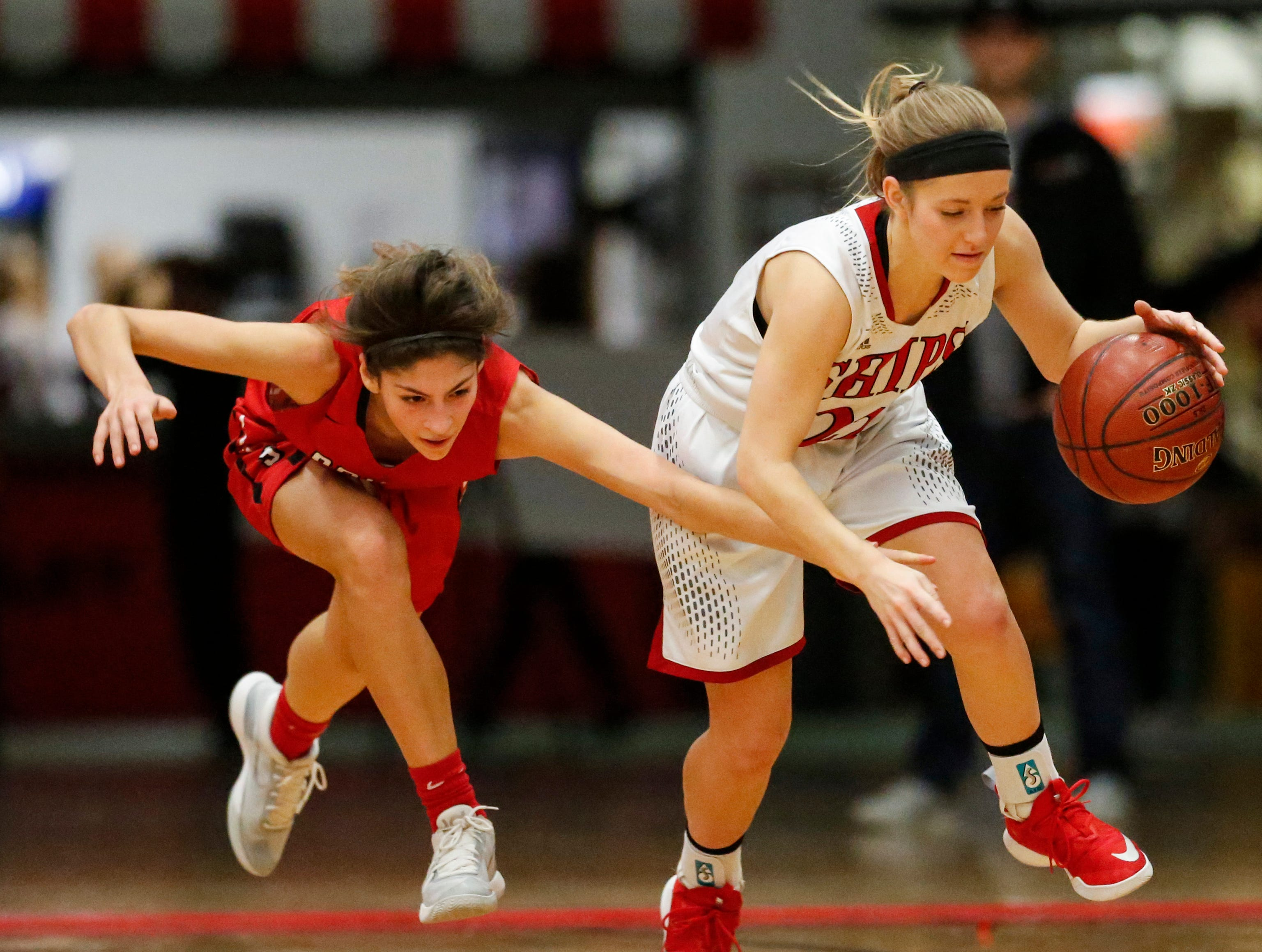 Manitowoc Lincoln's Carley Zimmer (22) steals the ball from Sheboygan South's Maddie Ognacevic (4) during an FRCC matchup at Manitowoc Lincoln High School Friday, January 4, 2019, in Manitowoc, Wis. Joshua Clark/USA TODAY NETWORK-Wisconsin