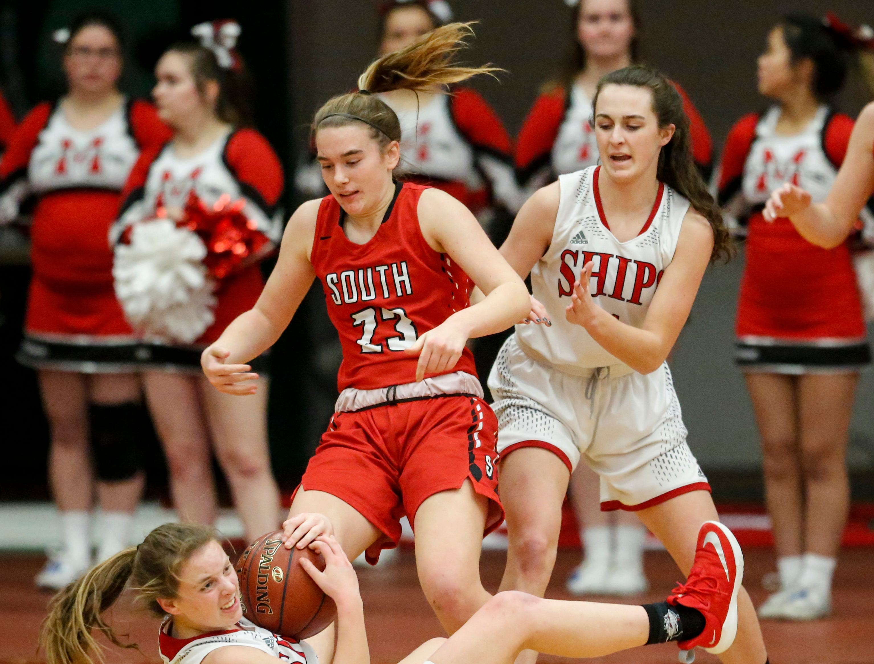 Manitowoc Lincoln's Shae Luer (15) dives for a loose ball after knocking it away from Sheboygan South's Halle Boldt (23) during an FRCC matchup at Manitowoc Lincoln High School Friday, January 4, 2019, in Manitowoc, Wis. Joshua Clark/USA TODAY NETWORK-Wisconsin