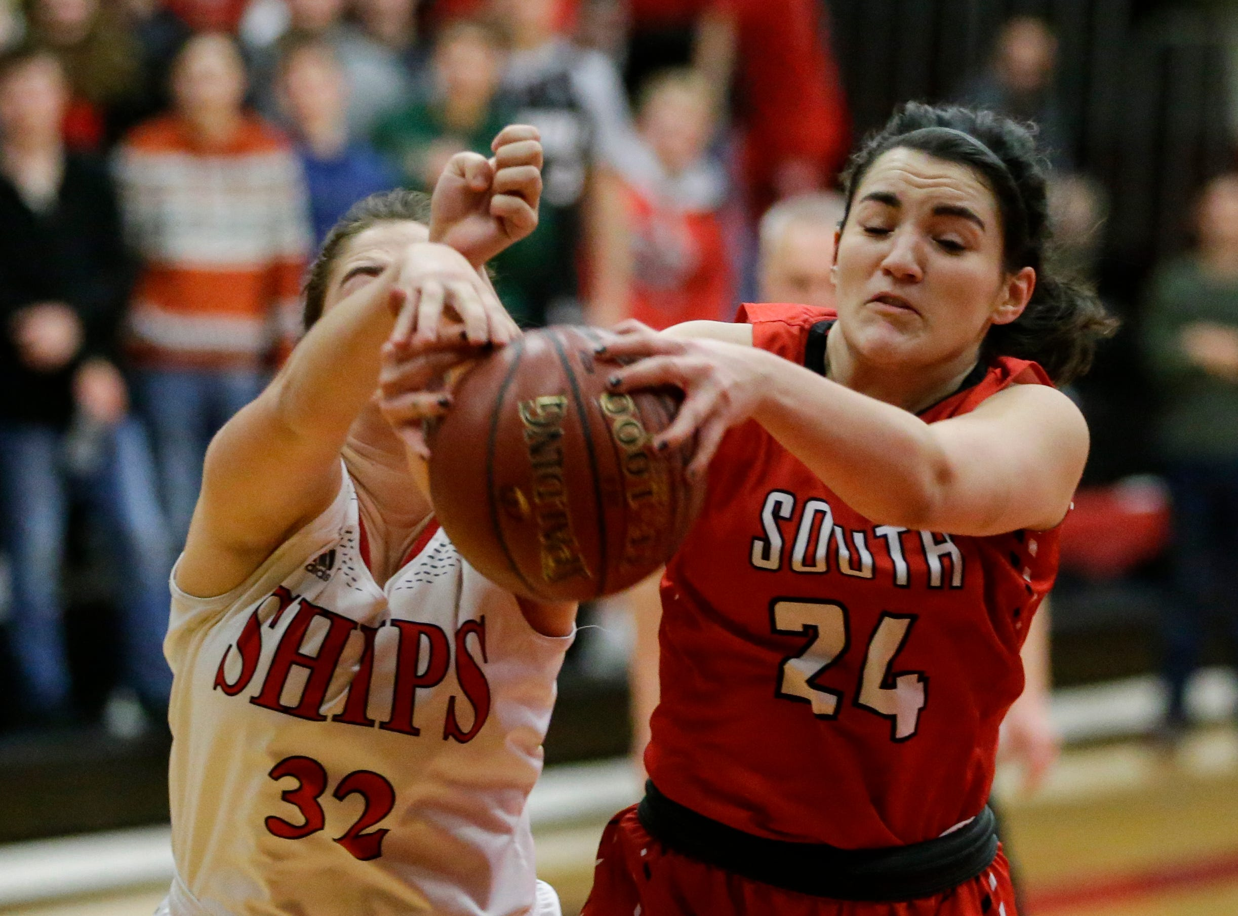 Sheboygan South's Amy Pfile battles Manitowoc Lincoln's Emily Balaban for the ball during an FRCC matchup at Manitowoc Lincoln High School Friday, January 4, 2019, in Manitowoc, Wis. Joshua Clark/USA TODAY NETWORK-Wisconsin