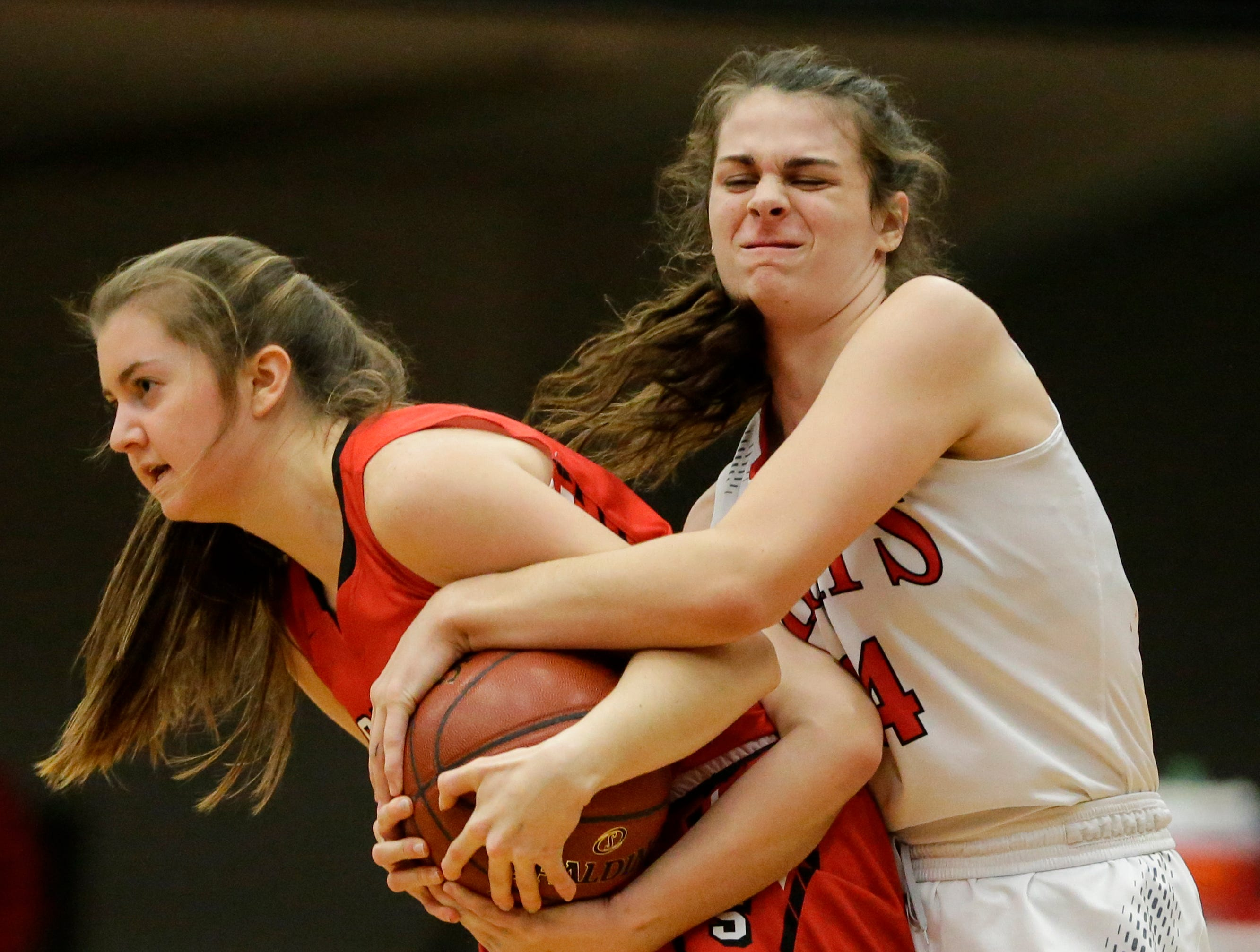 Manitowoc Lincoln's Claire Swoboda (14) gets tangled up with Sheboygan South's Abby Urben (22) for a jump ball during an FRCC matchup at Manitowoc Lincoln High School Friday, January 4, 2019, in Manitowoc, Wis. Joshua Clark/USA TODAY NETWORK-Wisconsin