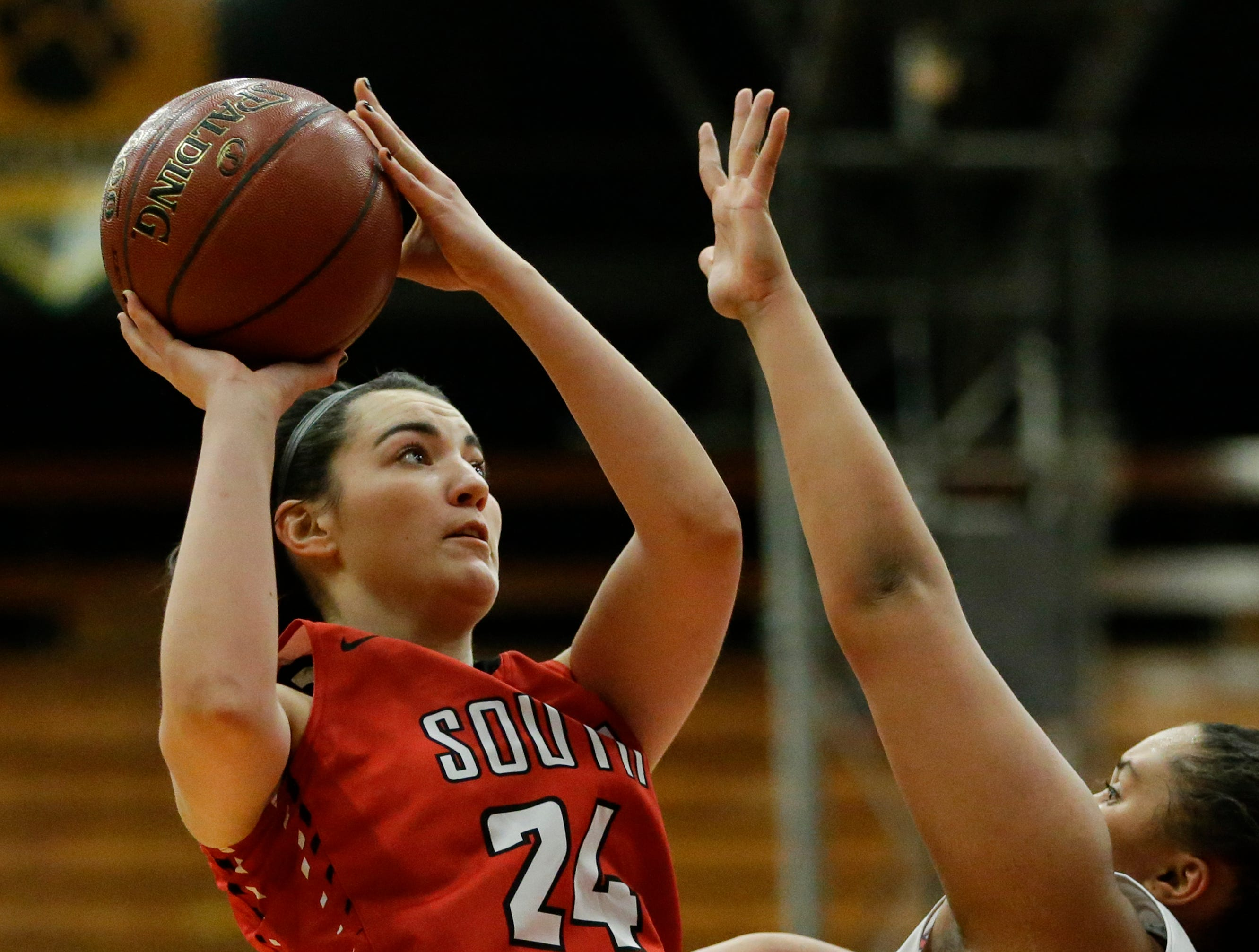 Sheboygan South's Amy Pfile shoots over Manitowoc Lincoln's Massendra Musial (40) during an FRCC matchup at Manitowoc Lincoln High School Friday, January 4, 2019, in Manitowoc, Wis. Joshua Clark/USA TODAY NETWORK-Wisconsin