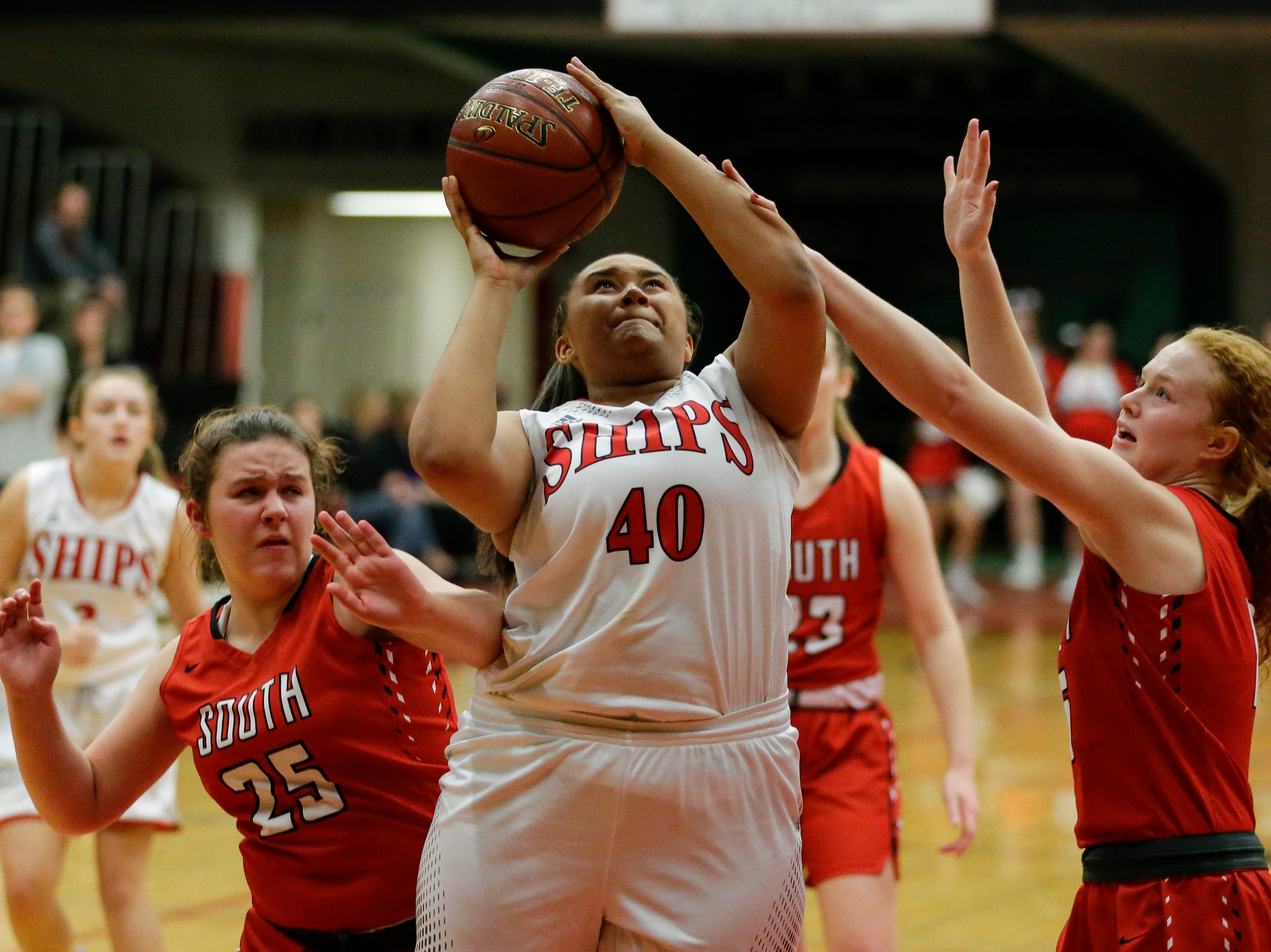 Manitowoc Lincoln's Massendra Musial is fouled as she shoots against Sheboygan South during an FRCC matchup at Manitowoc Lincoln High School Friday, January 4, 2019, in Manitowoc, Wis. Joshua Clark/USA TODAY NETWORK-Wisconsin