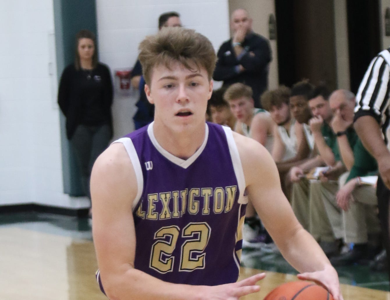 Lexington's Josh Aiello passes the ball while playing at Madison on Friday.