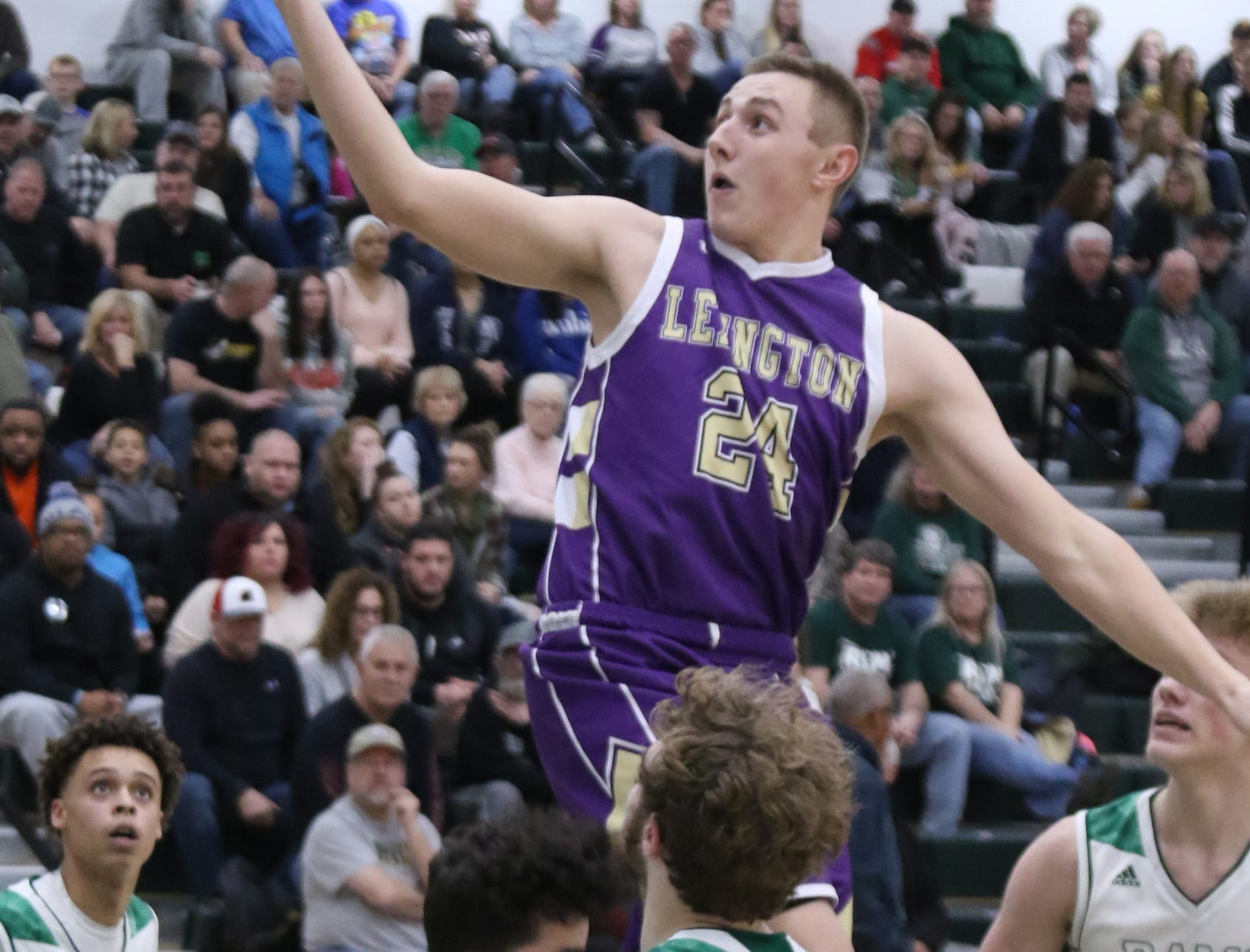 Lexington's Nick Stehle attempts a jump shot while playing at Madison on Friday.