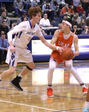 Lucas' Riley Gossom keeps the ball away from St. Peter's Luke Henrich on Friday.