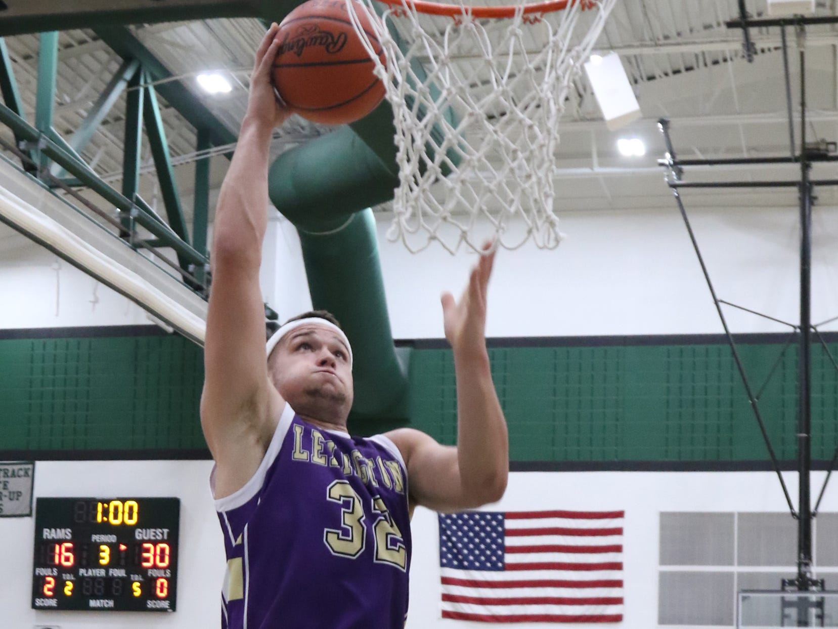 Lexington's Cade Stover dunks the ball while playing at Madison on Friday.