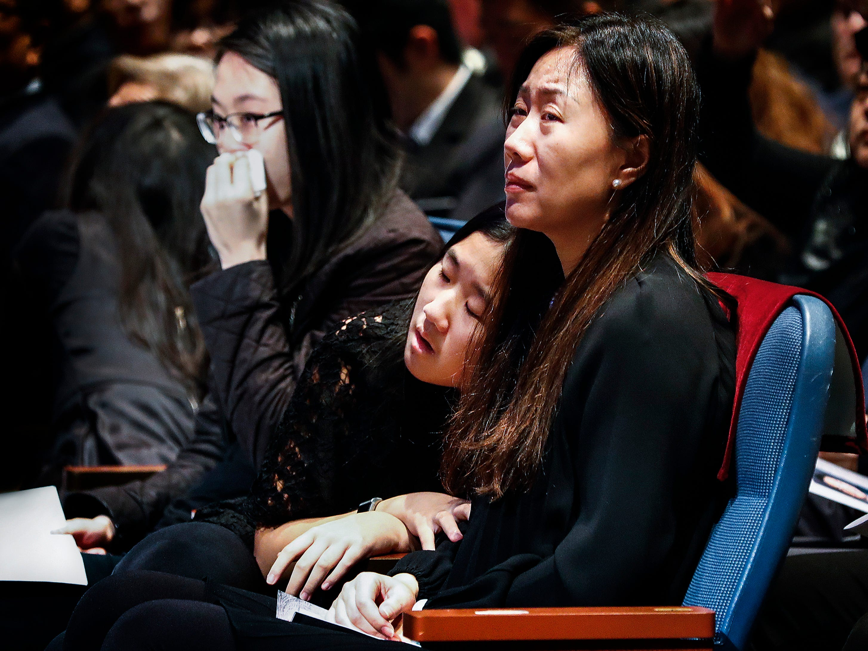 Isabel Chen (right) grieves with her daughters during a memorial service for her husband Wei Chen, a Memphis businessman who died along with three other people in a plane crash in Georgia.