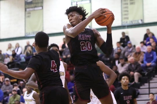 Memphis East's James Wiseman grabs a rebound against Holy Spirit during the Memphis Hoopfest at Briarcrest Christian School on Friday, Jan. 4, 2019.
