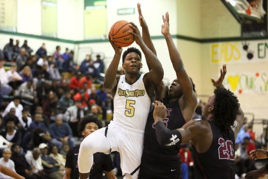 Holy Spirit's Anthony Edwards shoots the ball against Memphis East during the Memphis Hoopfest at Briarcrest Christian School on Friday, Jan. 4, 2019.