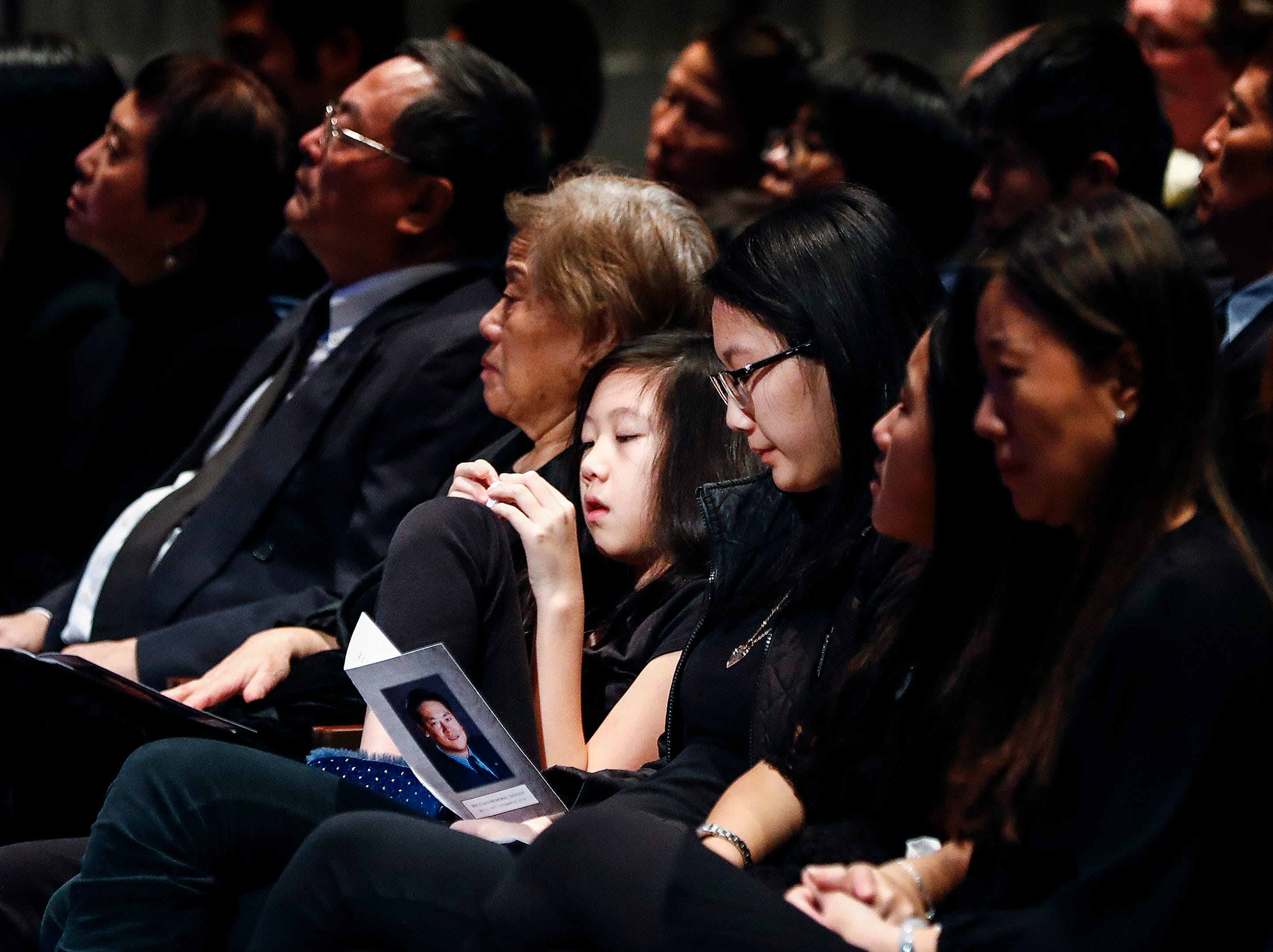 Family members attend a memorial service for Wei Chen, a Memphis businessman who died along with three other people in a plane crash in Georgia.