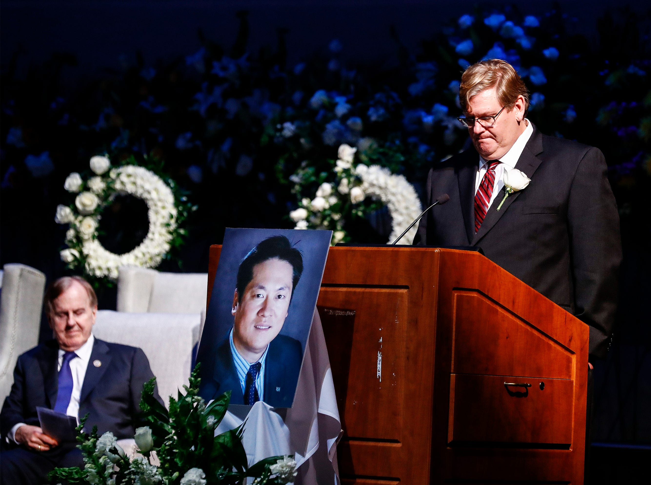 Mike McAnnally speaks during a memorial service for Wei Chen, a Memphis businessman who died along with three other people in a plane crash in Georgia. McAnnally, now heads Chen's company Sunshine Enterprise Inc., and is the only surviving executive. Company executives John Chen, Bruce Pelynio and Danielle Mitchell also died in the crash with Chen