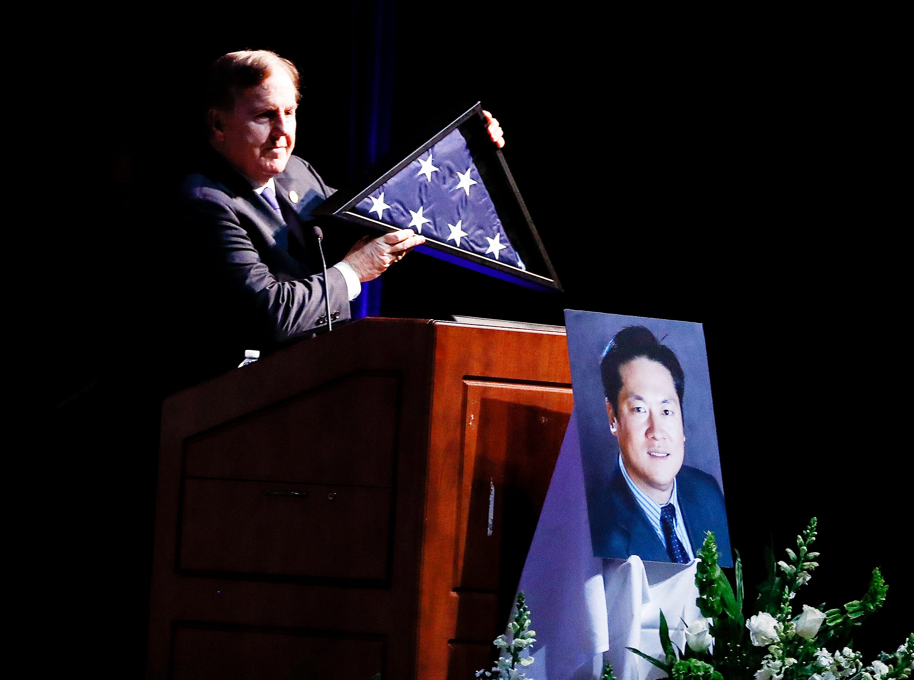 Family friend Congressman Robert Pittenger speaks during the memorial service for Wei Chen, a Memphis businessman who died along with three other people in a plane crash in Georgia.