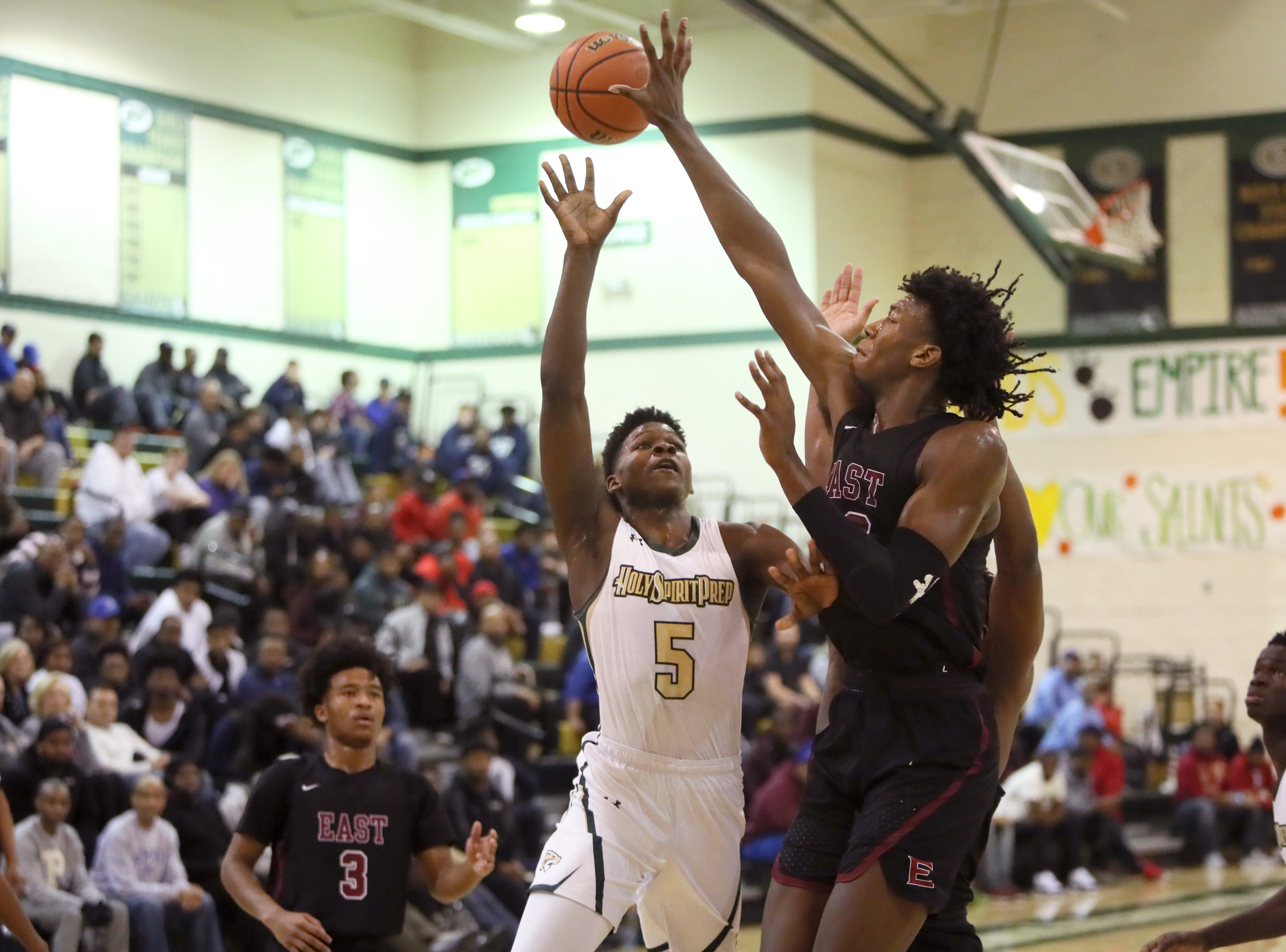Memphis East's James Wiseman blocks a shot by Holy Spirit's Anthony Edwards during the Memphis Hoopfest at Briarcrest Christian School on Friday, Jan. 4, 2019.