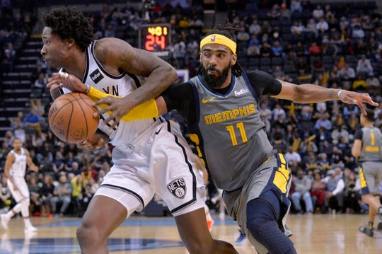 Memphis Grizzlies guard Mike Conley (11) knocks the ball loose from Brooklyn Nets forward Ed Davis during the second half of an NBA basketball game Friday, Jan. 4, 2019, in Memphis, Tenn. (AP Photo/Brandon Dill)