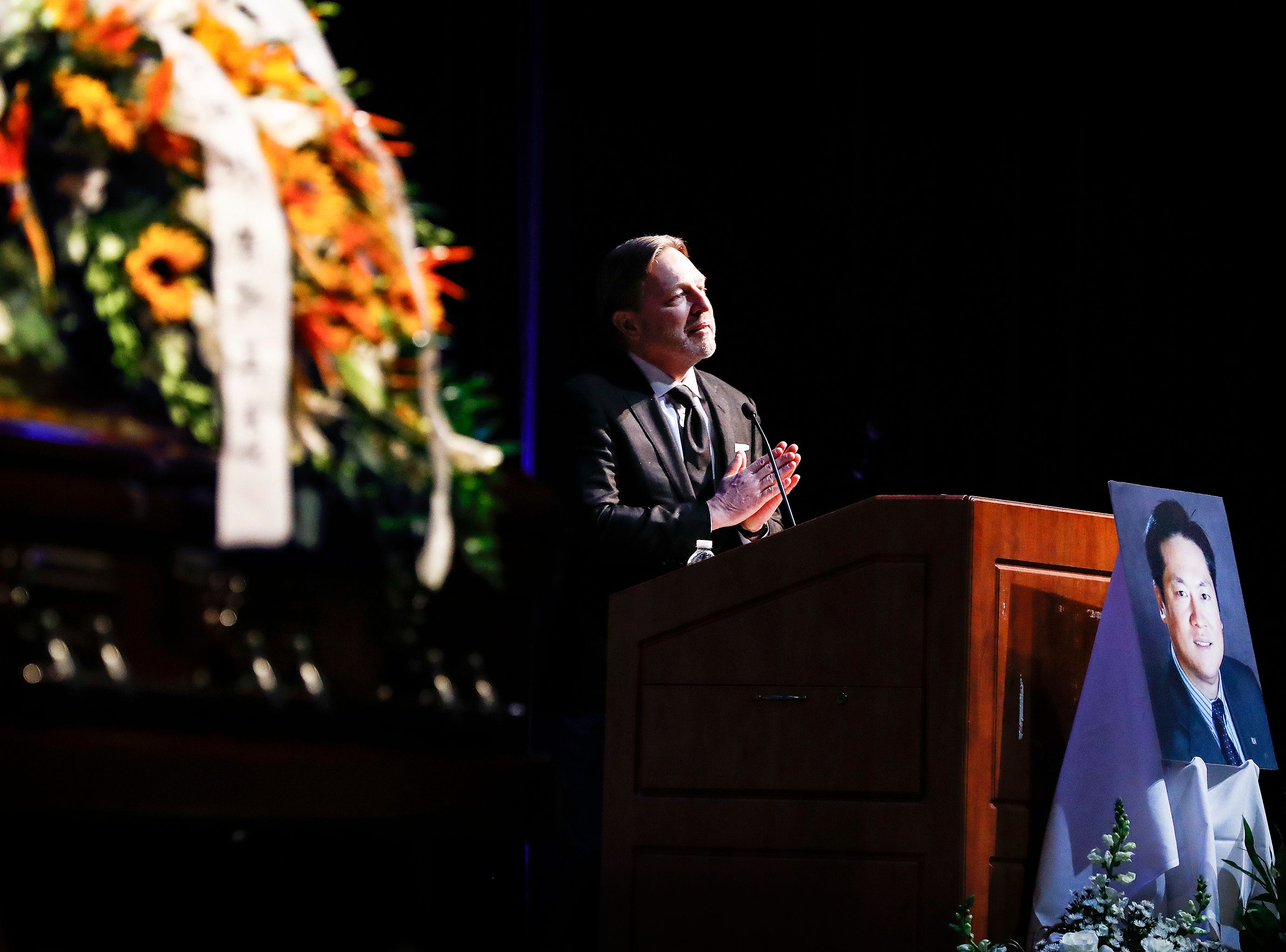 Family friend Verne Harnish speaks during a memorial service for Wei Chen, a Memphis businessman who died along with three other people in a plane crash in Georgia.