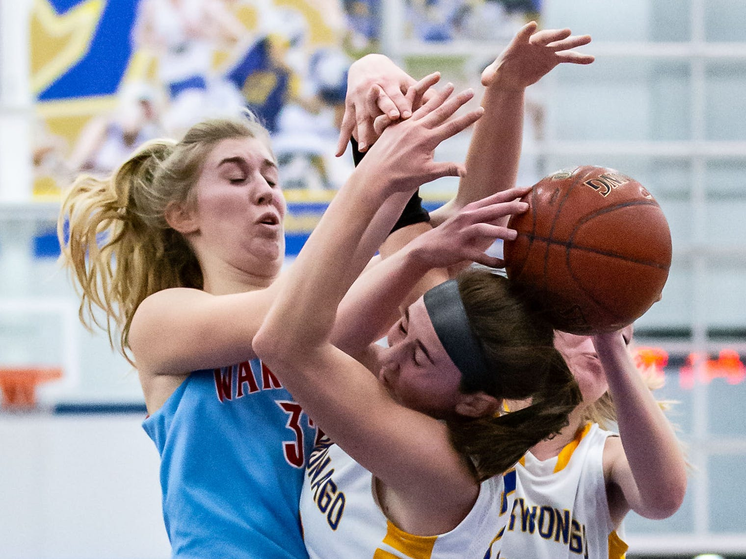 Arrowhead's Lauren With (left) battles for a rebound with Mukwonago's Angie Cera (22) and Dru Henning (33) during the game at Mukwonago on Friday, Jan. 4, 2019.