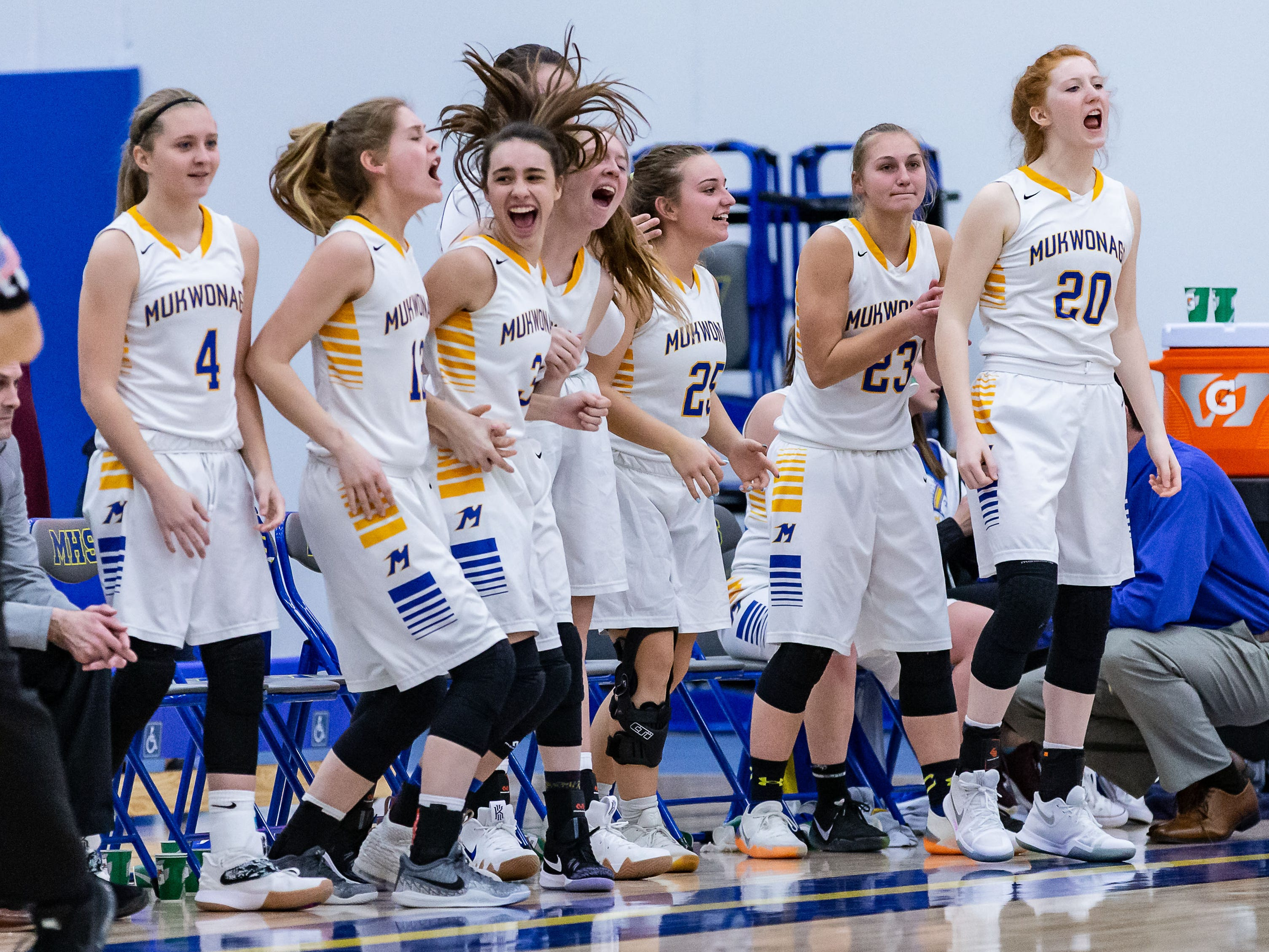 Mukwonago players celebrate a long three-pointer during the game at home against Arrowhead on Friday, Jan. 4, 2019.