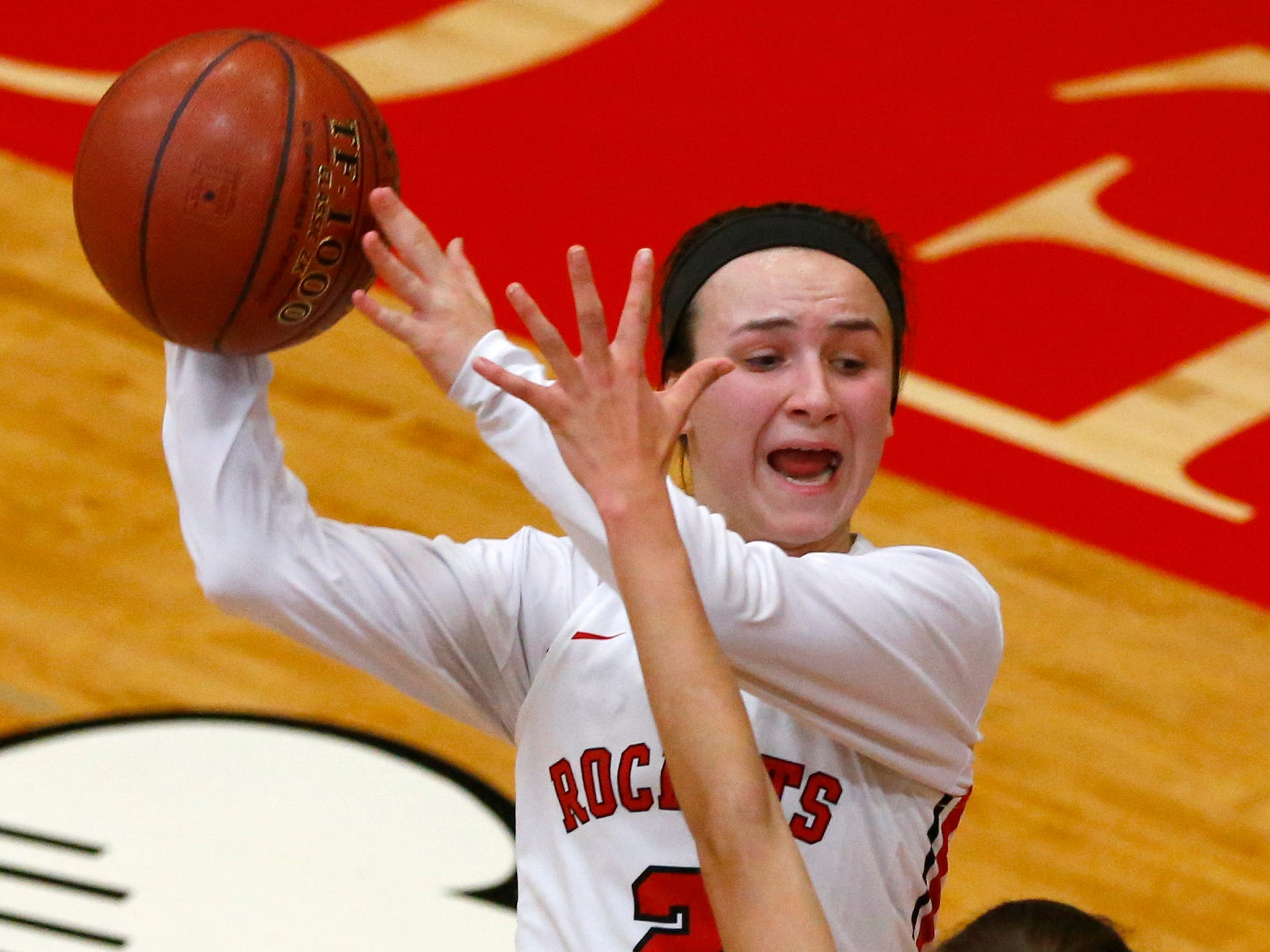 South Milwaukee's Julia Meyers passes over a Muskego defender at at South Milwaukee on Jan. 4.