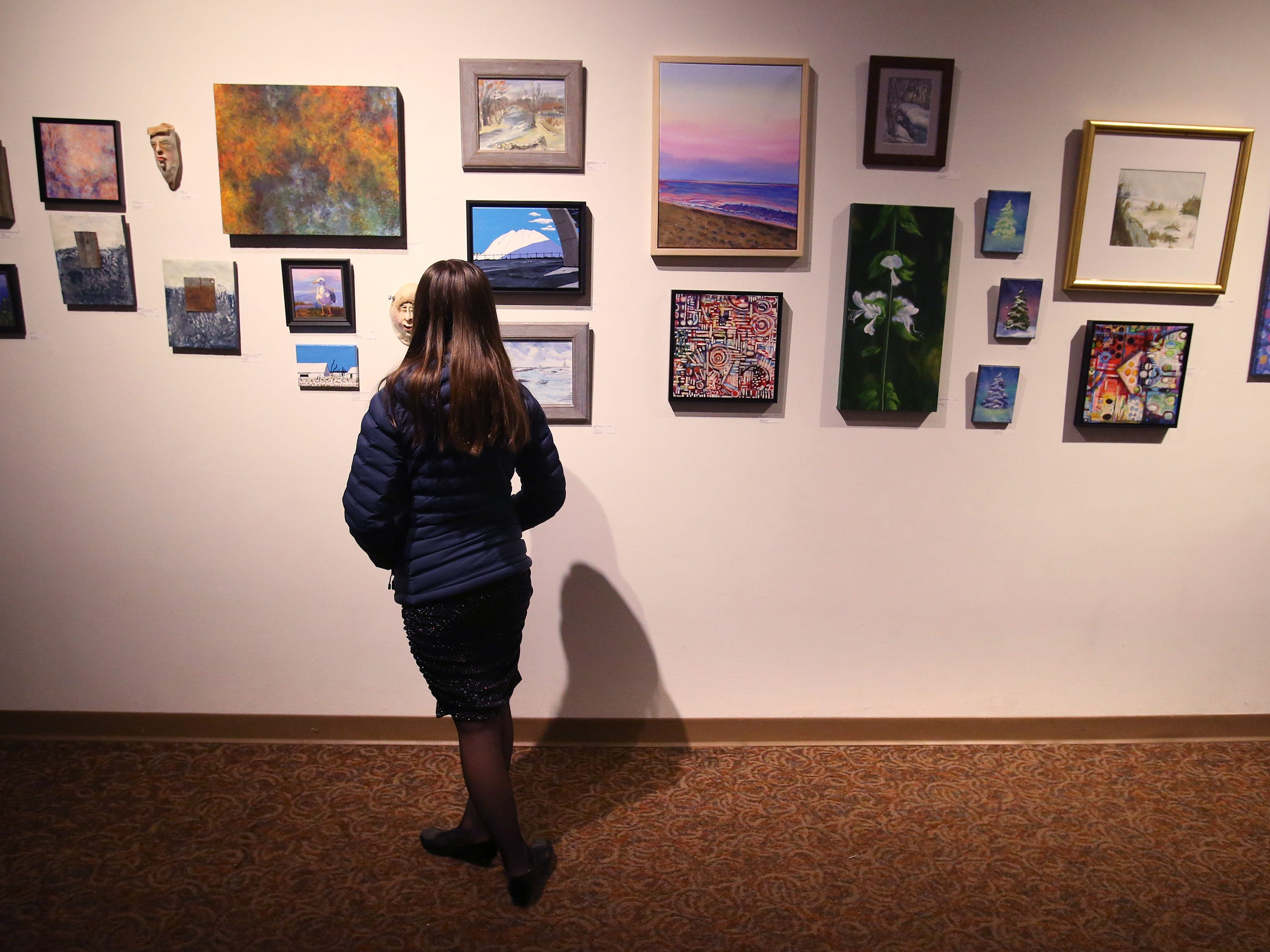 A guest examines the artwork on display in the Cedarburg Cultural Center during a First Fridays event on Jan. 4.