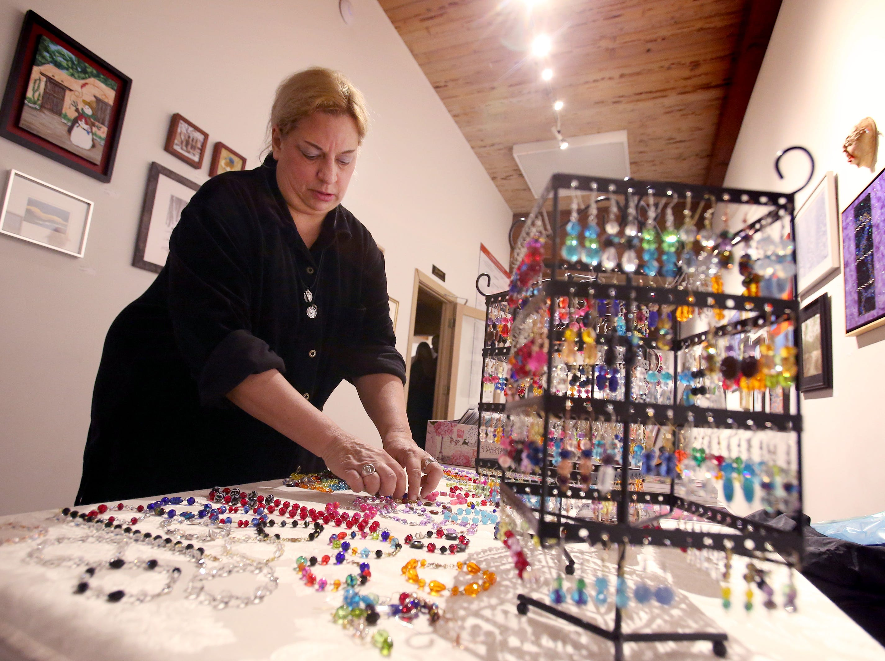 Sara Johann sets out her jewelry and artwork at the Cedarburg Cultural Center during a First Fridays event on Jan. 4.