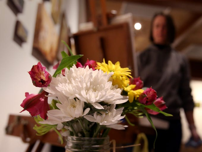 Michelle Savas-Thompson paints a still life of flowers and grapes at the Cedarburg Cultural Center during a First Fridays event on Jan. 4.