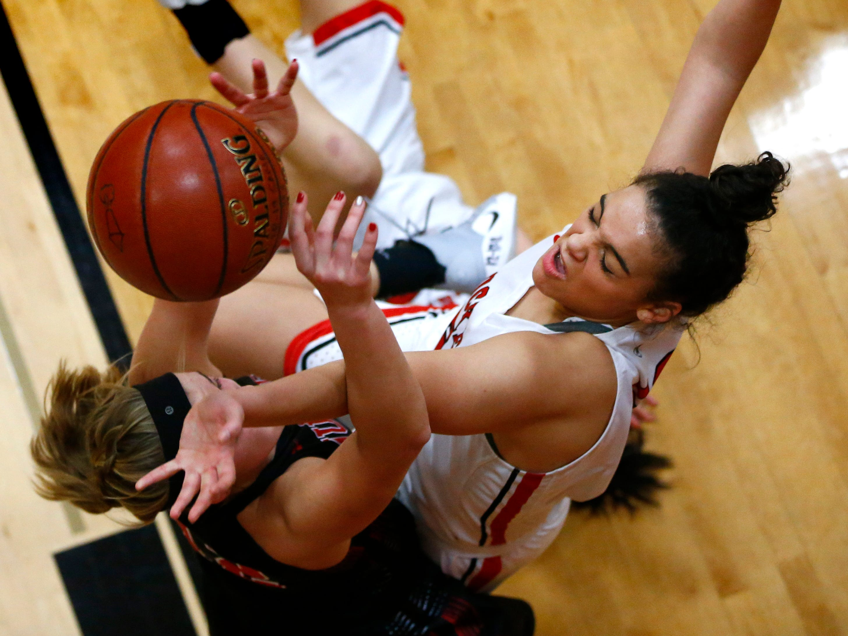 Muskego's Sara Jochims is fouled by South Milwaukee's Araia Breedlove at South Milwaukee on Jan. 4.