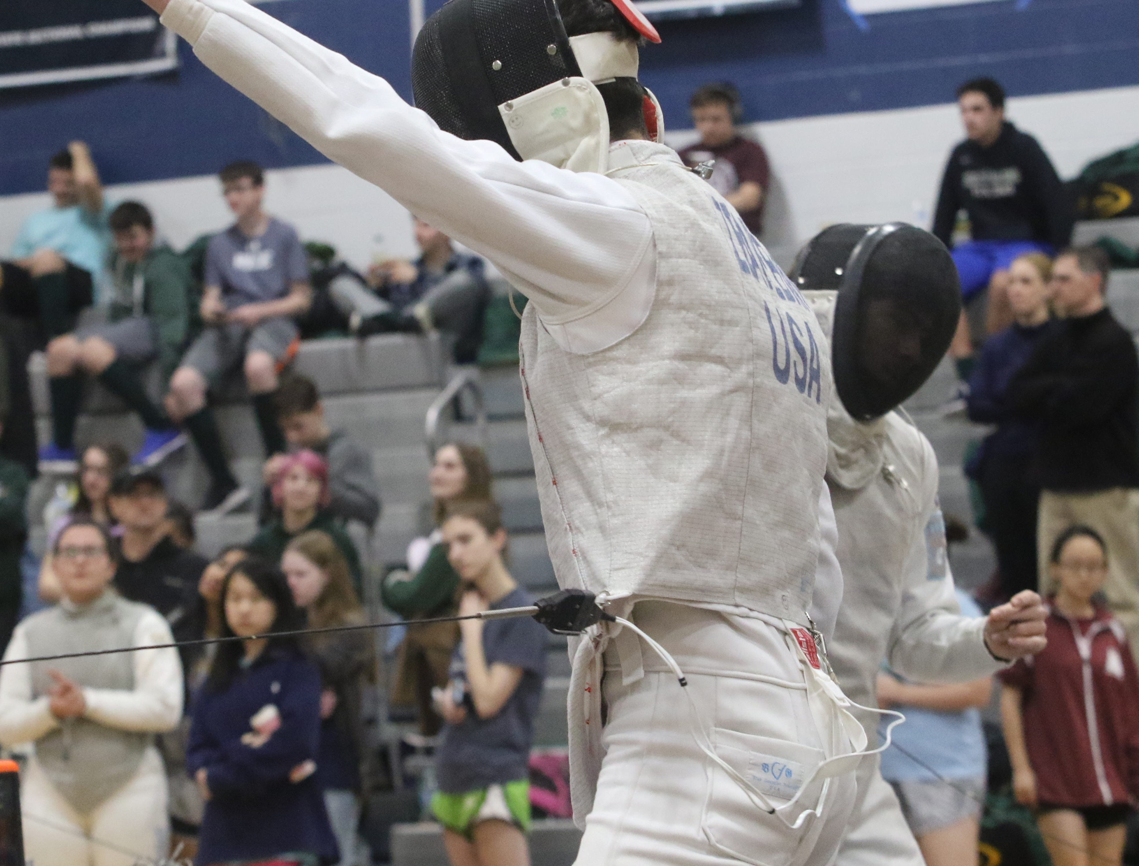Zak Zeareban of Chatham celebrates a point against his opponent, Nate Mange of West Morris in the foil final.