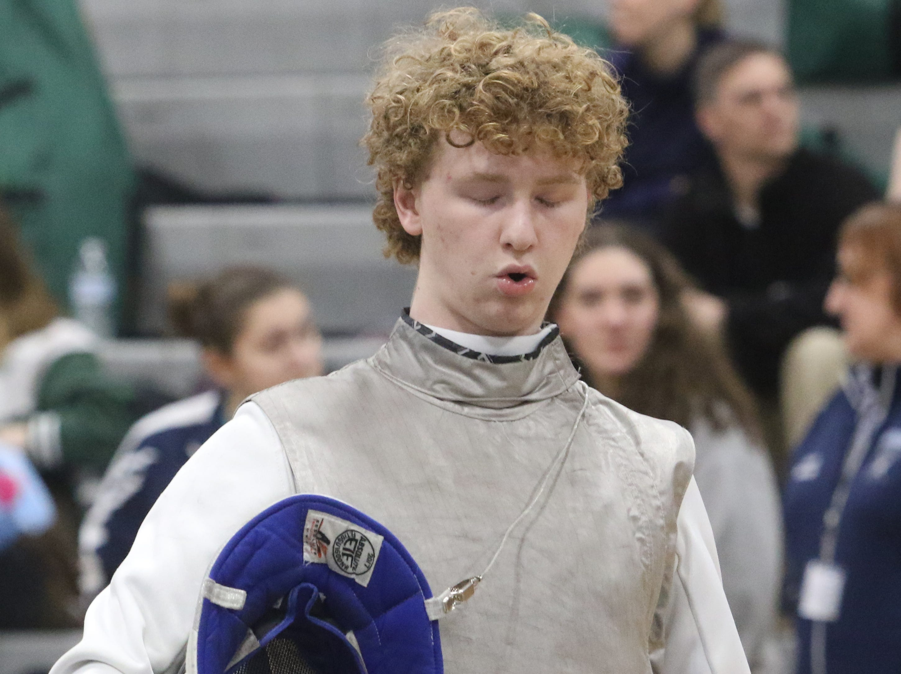 Euwen Brennan of Morristown takes a deep breath before starting the foil finals.