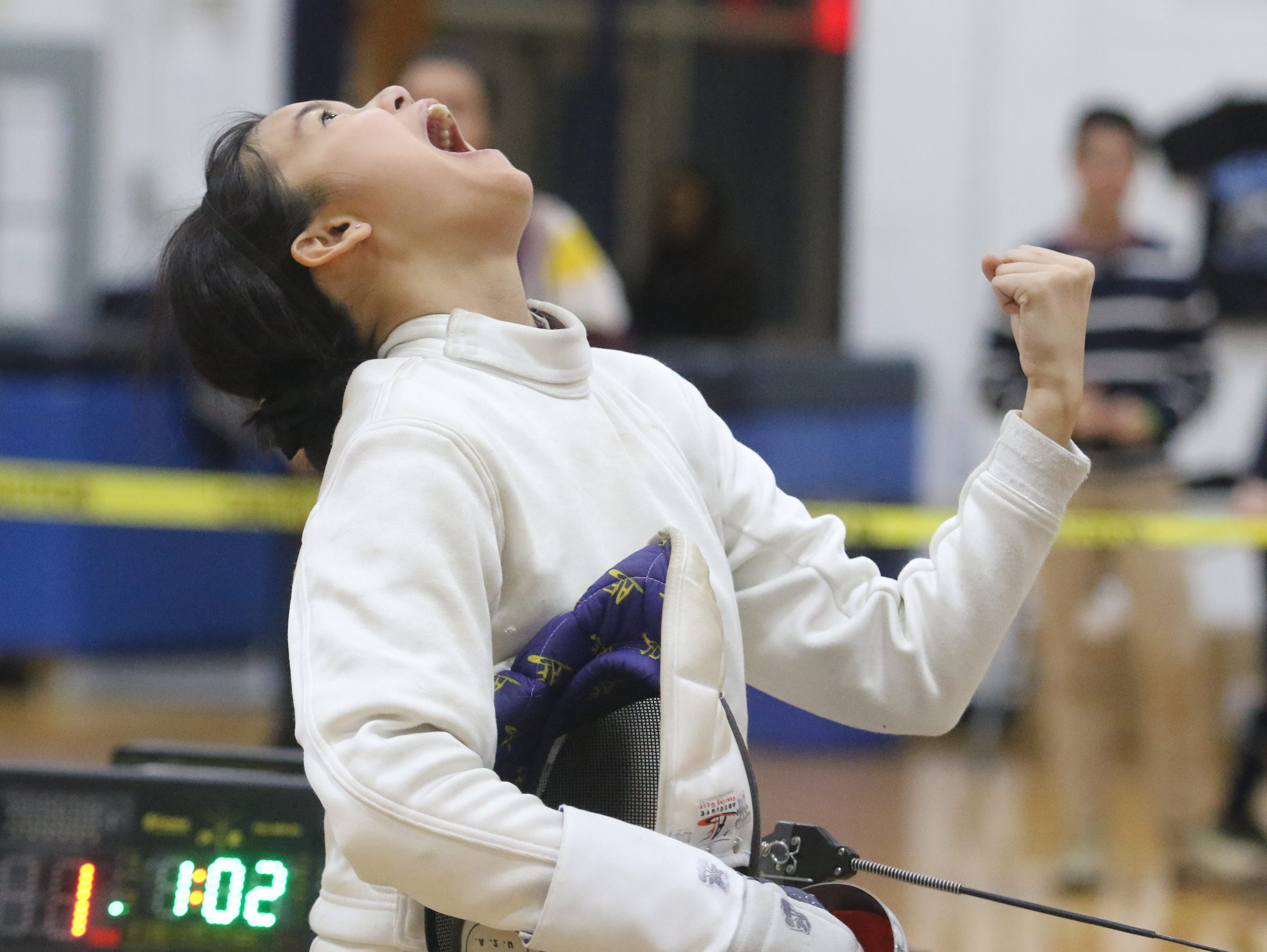 Alison Cordero of Randolph after she won a bout during the Morris County Tournament epee final.
