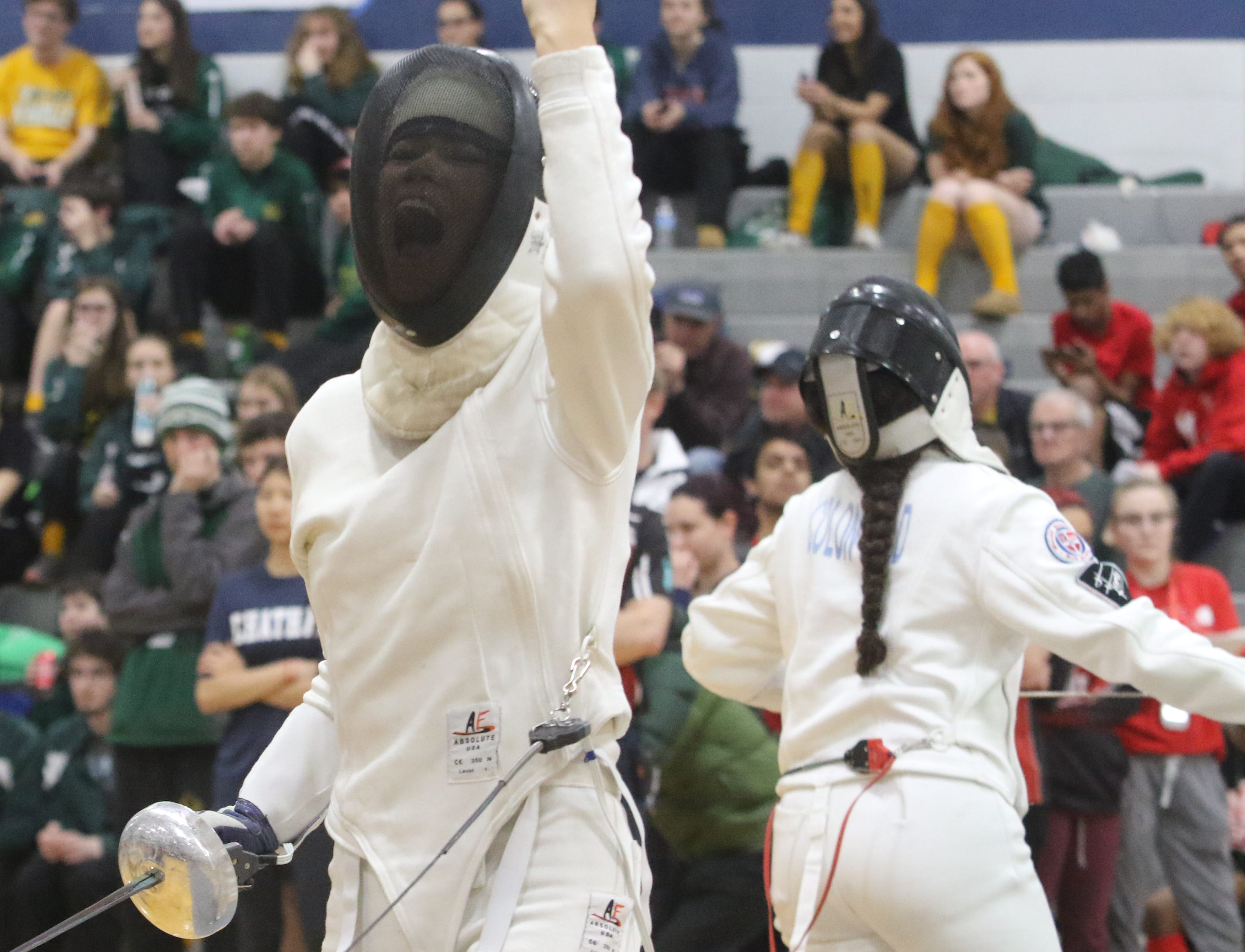 Alison Cordero of Randolph celebrates a point in the epee final.