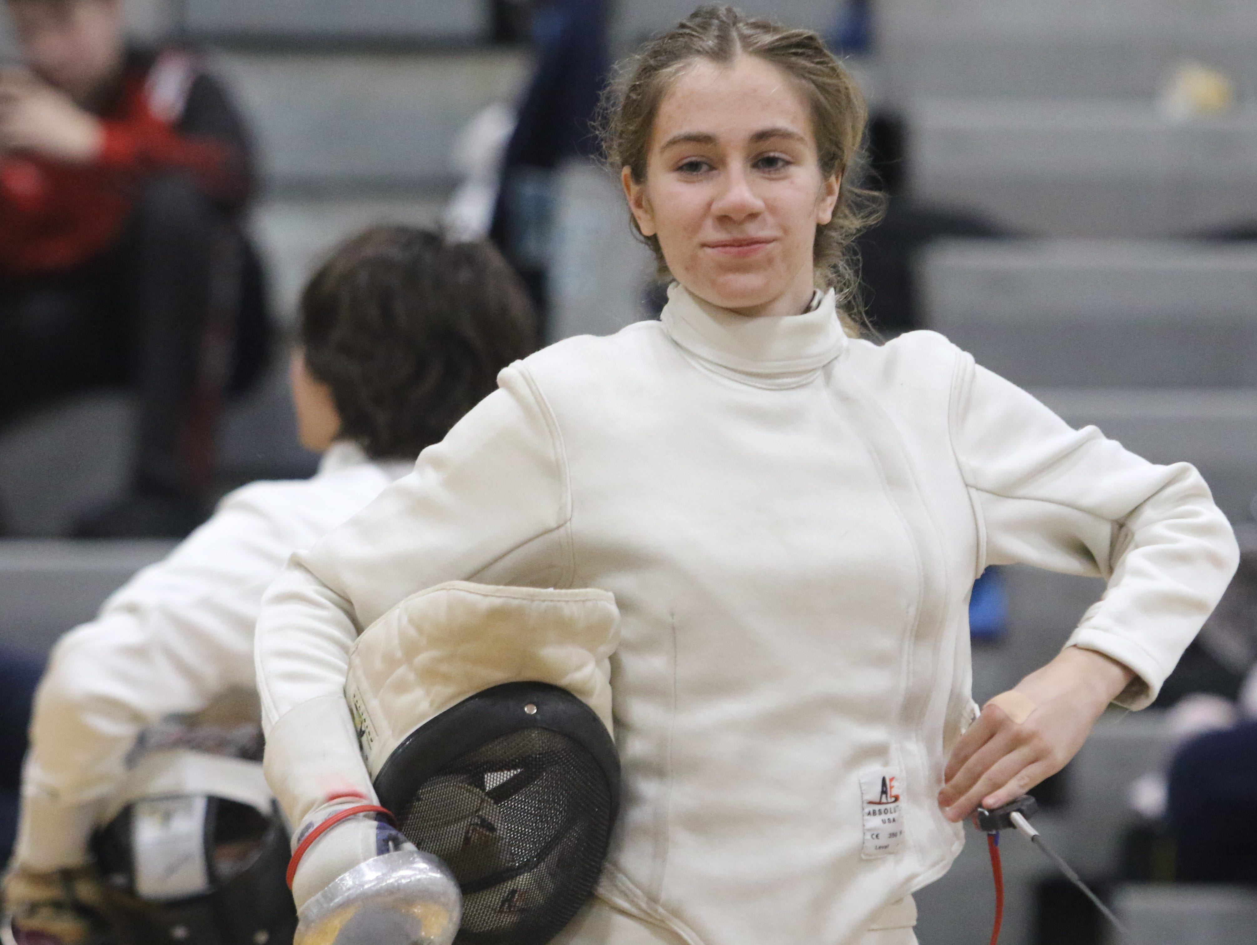 Alexandra Szwec of Morris Hills winning a round in the epee final.
