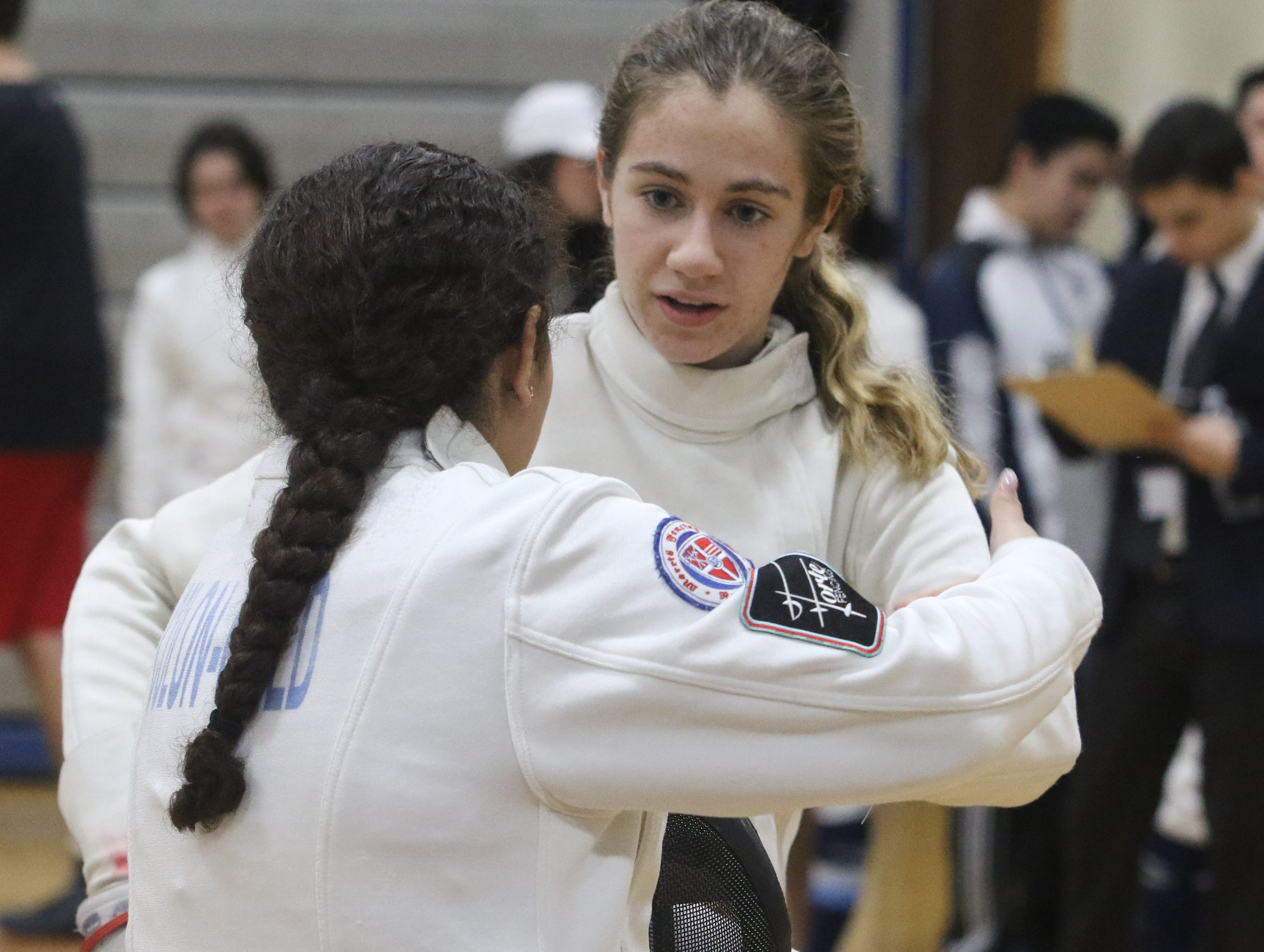 Hannah Colon-Gold of Morris Hills shakes hands with Alexandra Szwec of Morris Hills as they compete in the epee final.