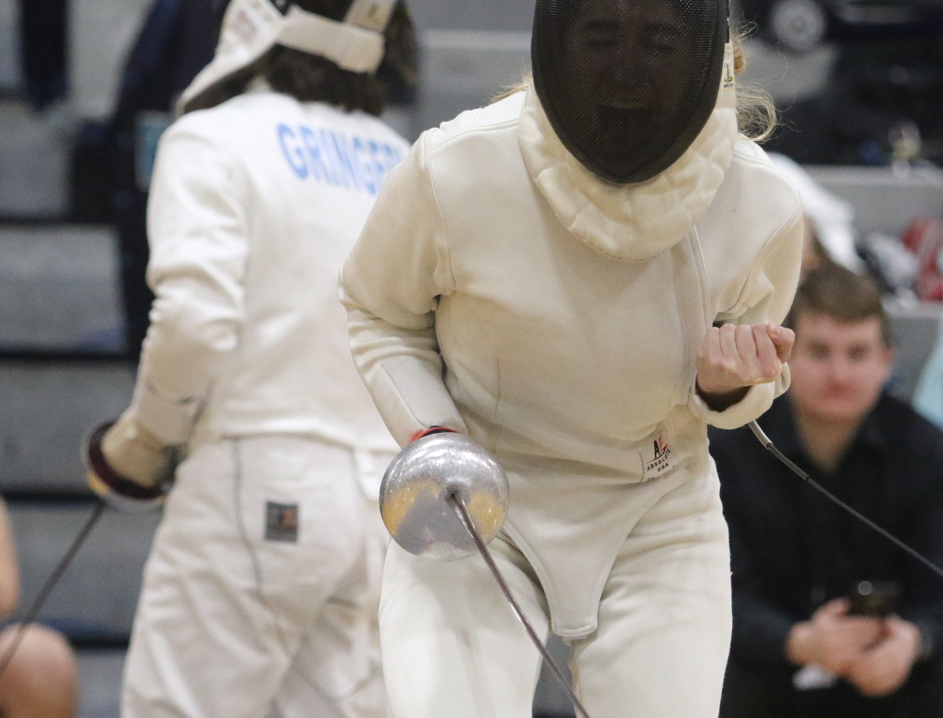 Alexandra Szwec of Morris Hills celebrates a point against Abigail Gringeri of Morristown in the epee final.