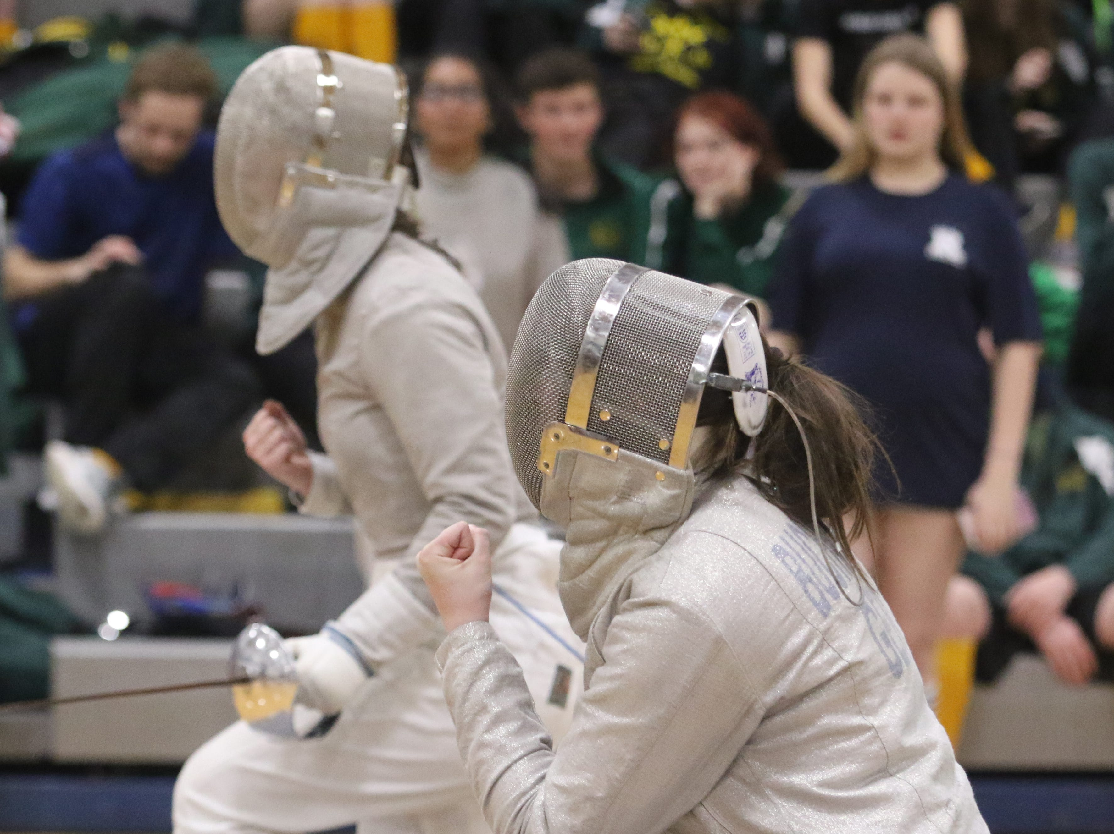 Julia Yellen of Randolph and Vivien Buchmann of Kinnelon as they each celebrate a point in the saber final.