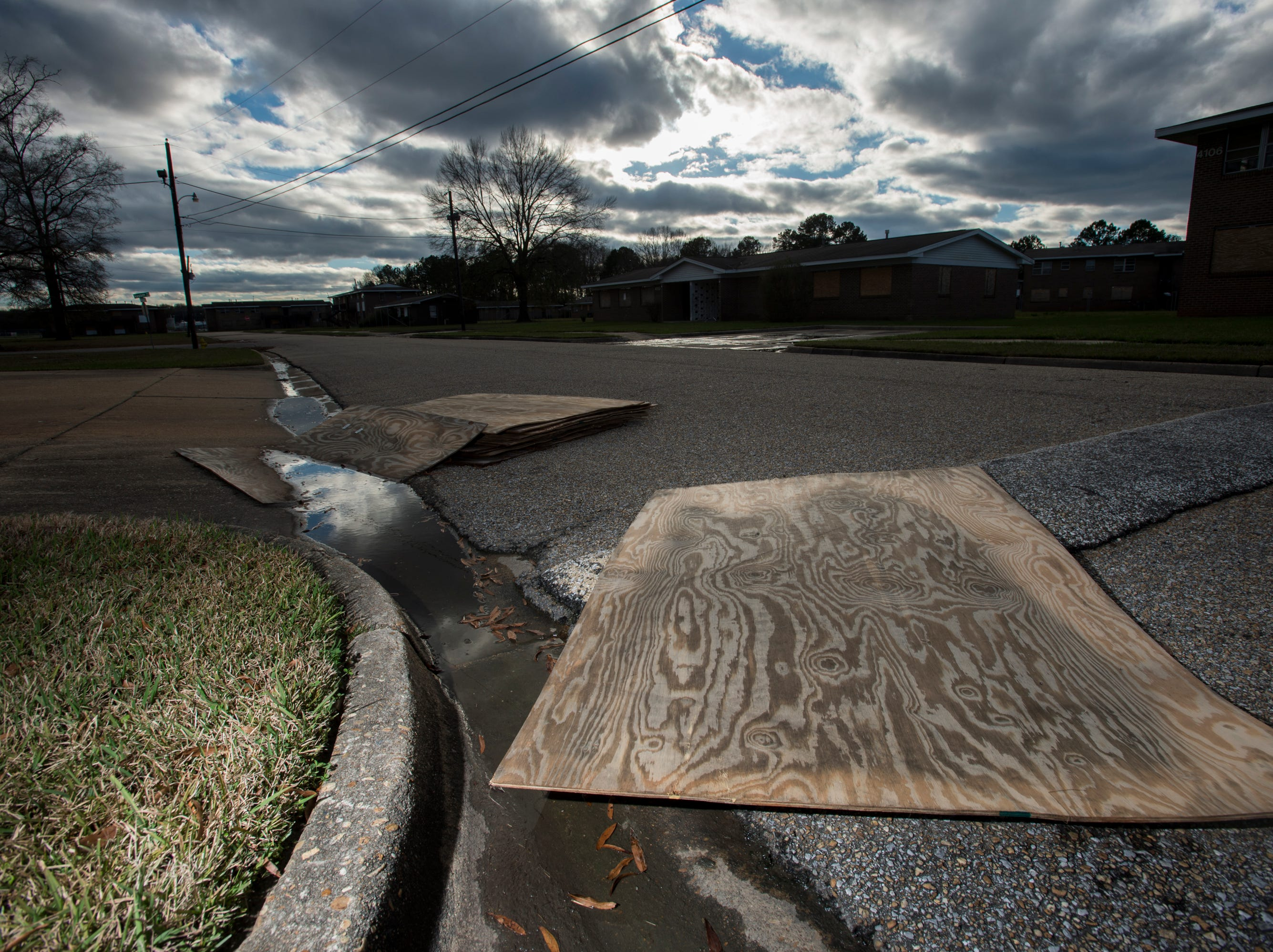 Boards sit in the road at the completely vacated Smiley Court in Montgomery, Ala., on Friday, Jan. 4, 2019.